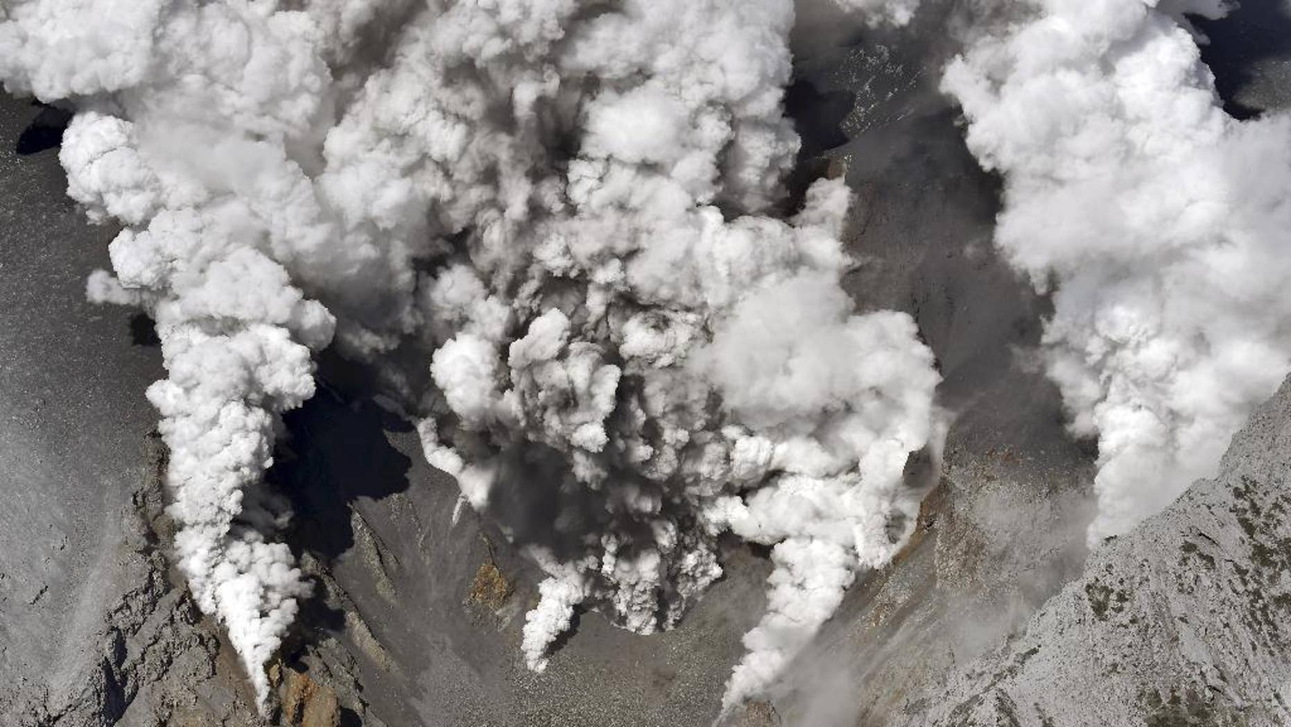 Sept. 27, 2014: Dense fumes are spewed out from several spots on the slope of Mt. Ontake as the volcano erupts in central Japan.