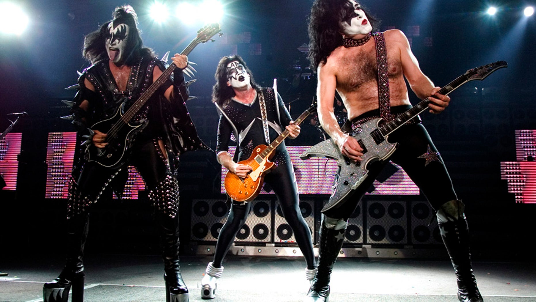 The rock band Kiss, from left, Gene Simmons, Tommy Thayer and Paul Stanley perform during their performance at the PNC Bank Arts Center in Holmdel, N.J. on Tuesday, July 20, 2004.