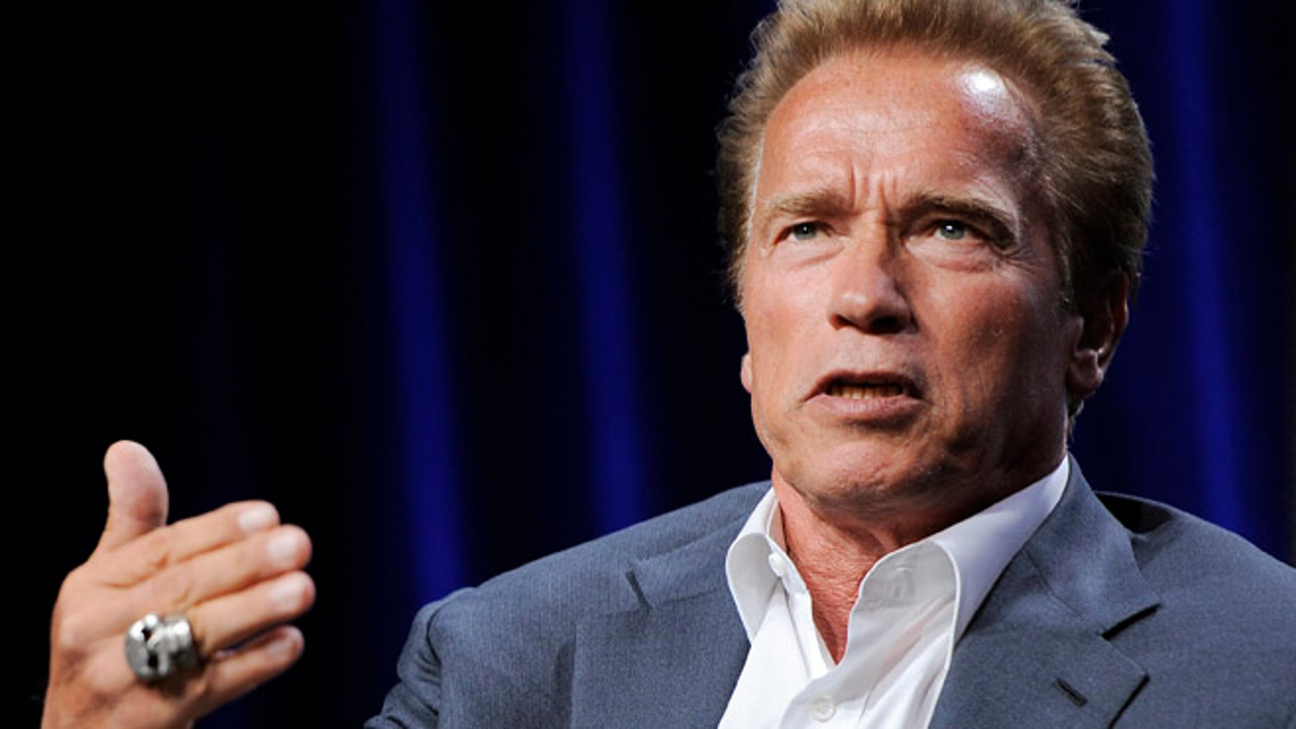 """Former California Gov. Arnold Schwarzenegger, the subject of a forthcoming ESPN short film, answers a question during the ESPN Films """"30 for 30 Shorts"""" TCA panel discussion at the Beverly Hilton hotel on Friday, Aug. 3, 2012 in Beverly Hills, Calif. The film will focus on Schwarzenegger's teenage years in the Austrian army. (Photo by Chris Pizzello/Invision/AP)"""