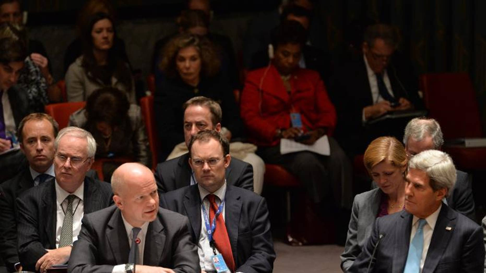 British Foreign Minister William Hague (L) speaks in the UN Security Council just after it voted to approve a resolution that will require Syria to give up its chemical weapons, on September 27, 2013 at the UN headquarters in New York