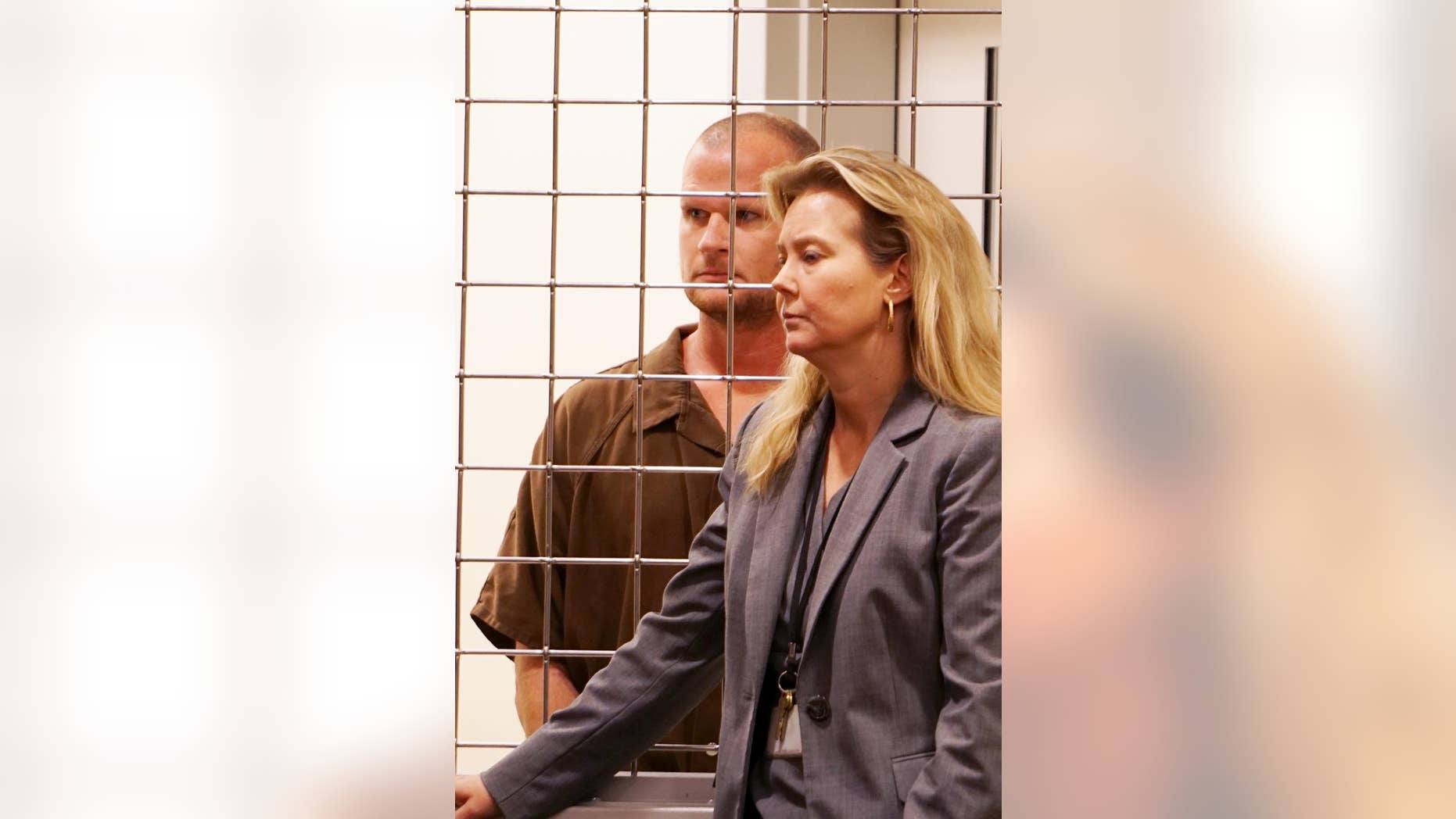 In a Monday, Sept. 12, 2016 photo, Seth Willis Pickering, 36, appears with LeeAnn Melton, Buncombe County public defender, in Buncombe County Court in Ashland, NC.  Pickering is charged first-degree murder in the death of his 6-year-old daughter, Lila Pickering. Pickering said he killed his daughter so that no one could take her from him again, a federal agent says in an affidavit. (Tonya Maxwell/Asheville Citizen-Times via AP)