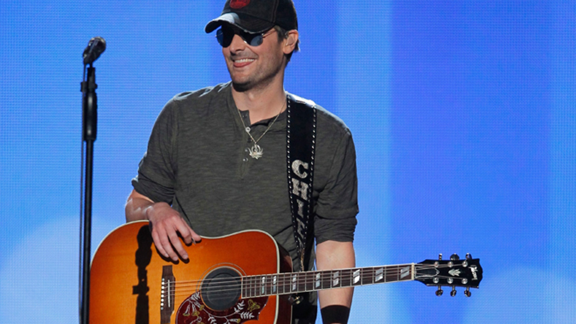 """Singer Eric Church smiles after performing """"Springsteen"""" at the 47th annual Academy of Country Music Awards in Las Vegas, Nevada, April 1, 2012."""