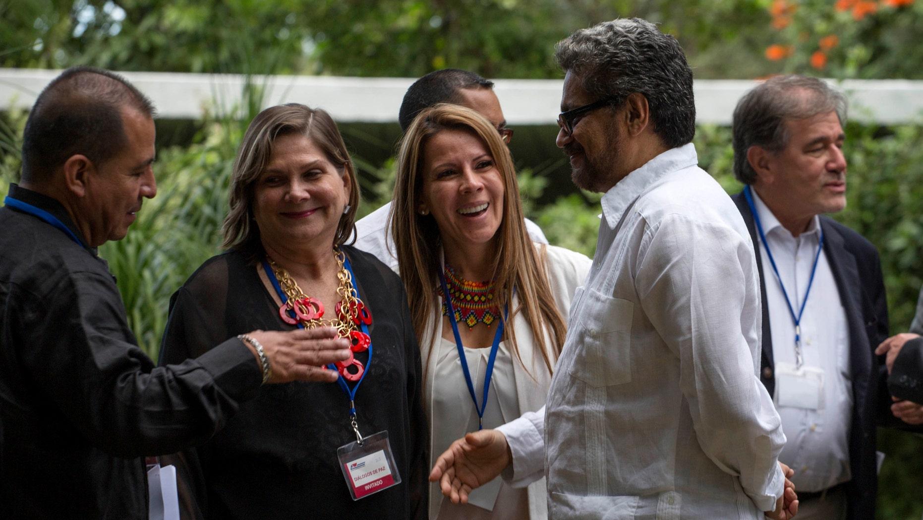 Ivan Marquez, FARC's chief negotiator, meets with representatives of victims in Havana, Cuba, on Dec. 16, 2014.