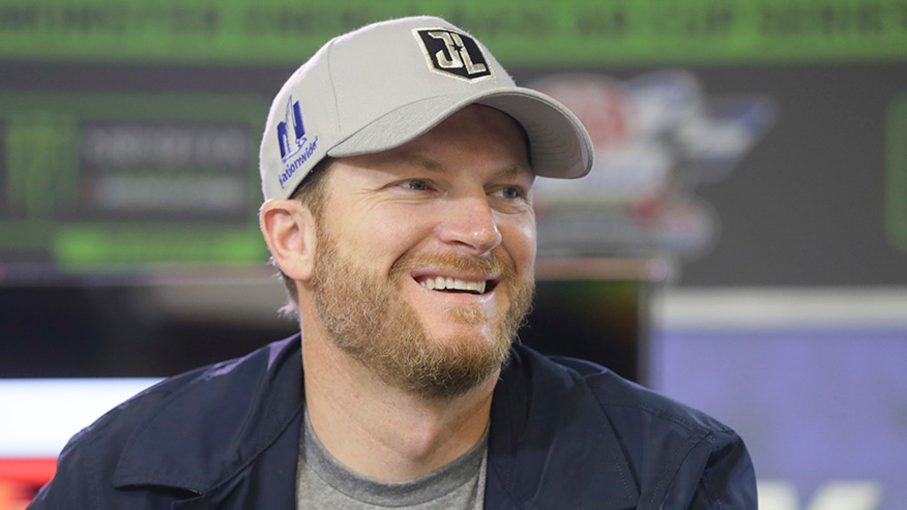 Dale Earnhardt Jr. smiles during a media availability before a weekend NASCAR Cup series auto race at Texas Motor Speedway in Fort Worth, Texas, Friday, Nov. 3, 2017. Earnhardt Jr.(AP Photo/LM Otero)