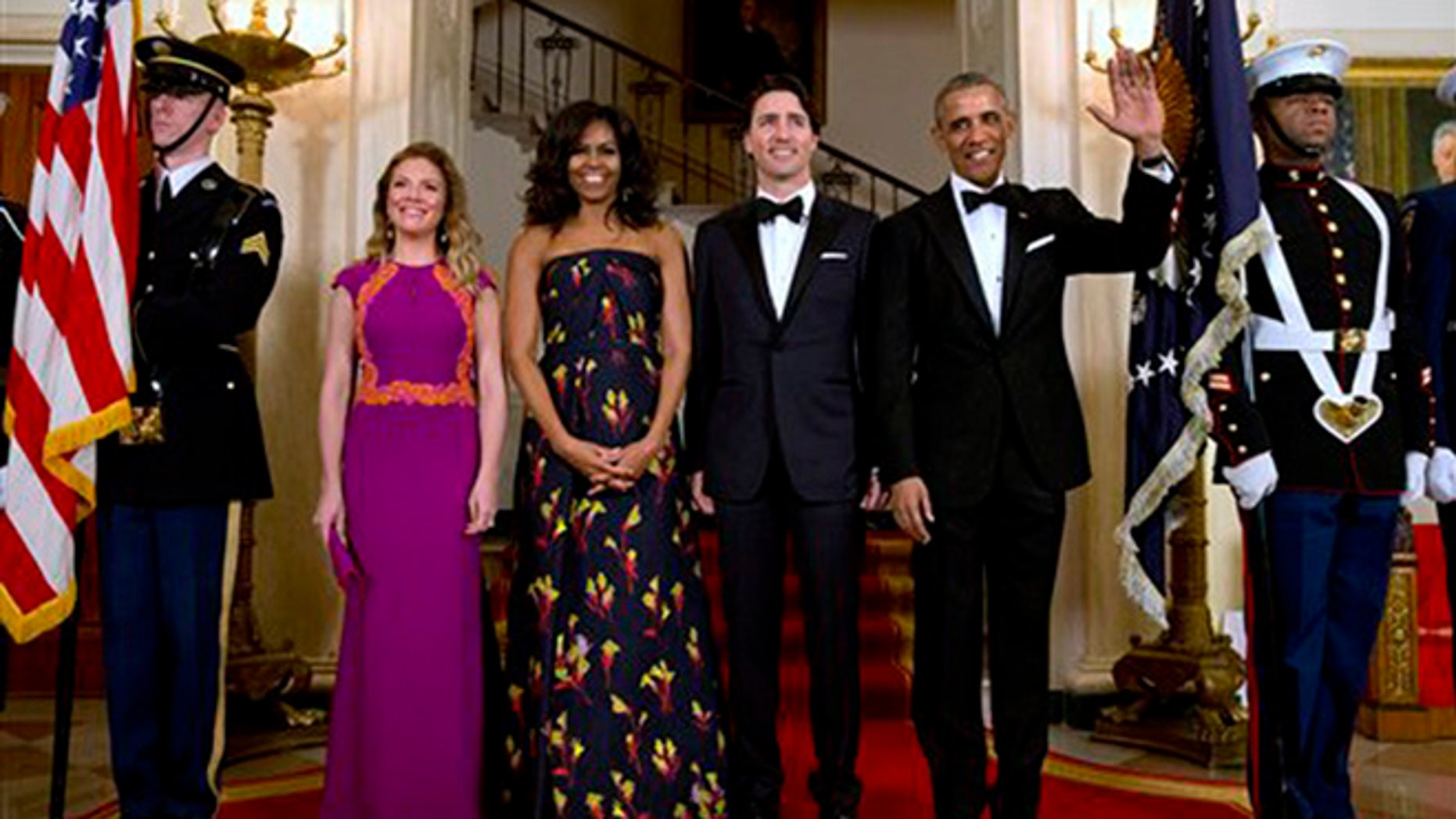 President Barack Obama, right, waves with from left, Sophie Grégoire Trudeau, first lady Michelle Obama, and Canadian Prime Minister Justin Trudeau, as they pose for a photograph at the White House during the State Dinner in Washington, Thursday, March 10, 2016. (AP Photo/Jacquelyn Martin)