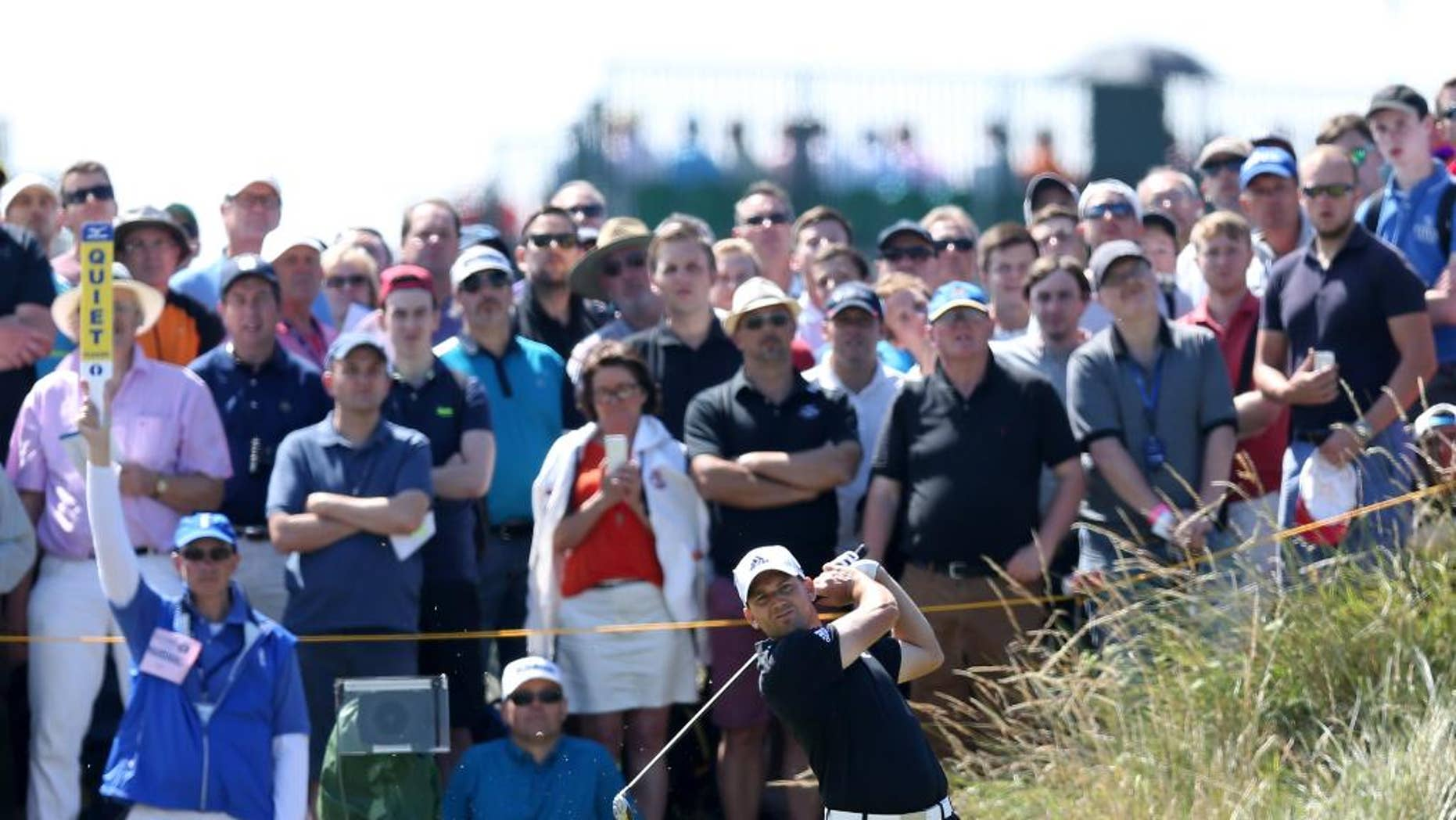 Sergio Garcia of Spain plays a shot off the 14th tee during the first day of the British Open Golf championship at the Royal Liverpool golf club, Hoylake, England, Thursday July 17, 2014. (AP Photo/Scott Heppell)