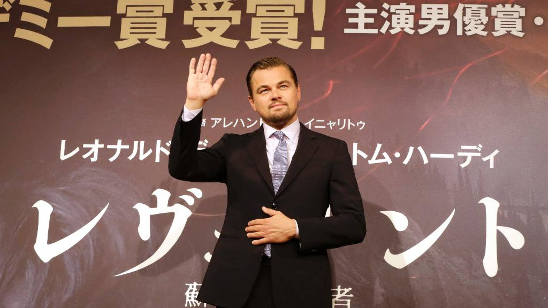"FILE - In this Wednesday, March 23, 2016, Actor Leonardo DiCaprio waves during a photo session of the movie ""The Revenant"" in Tokyo. An Indonesian immigration official says Hollywood actor Leonardo DiCaprio may be banned from returning to Indonesia over his criticisms that palm oil plantations are destroying the country's rainforests. (AP Photo/Eugene Hoshiko, File)"