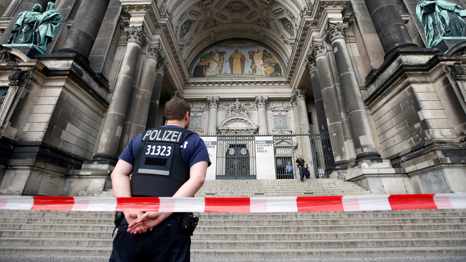 Police opened fire Sunday at a man who was rampaging near Berlin's cathedral, wounding him in the legs.