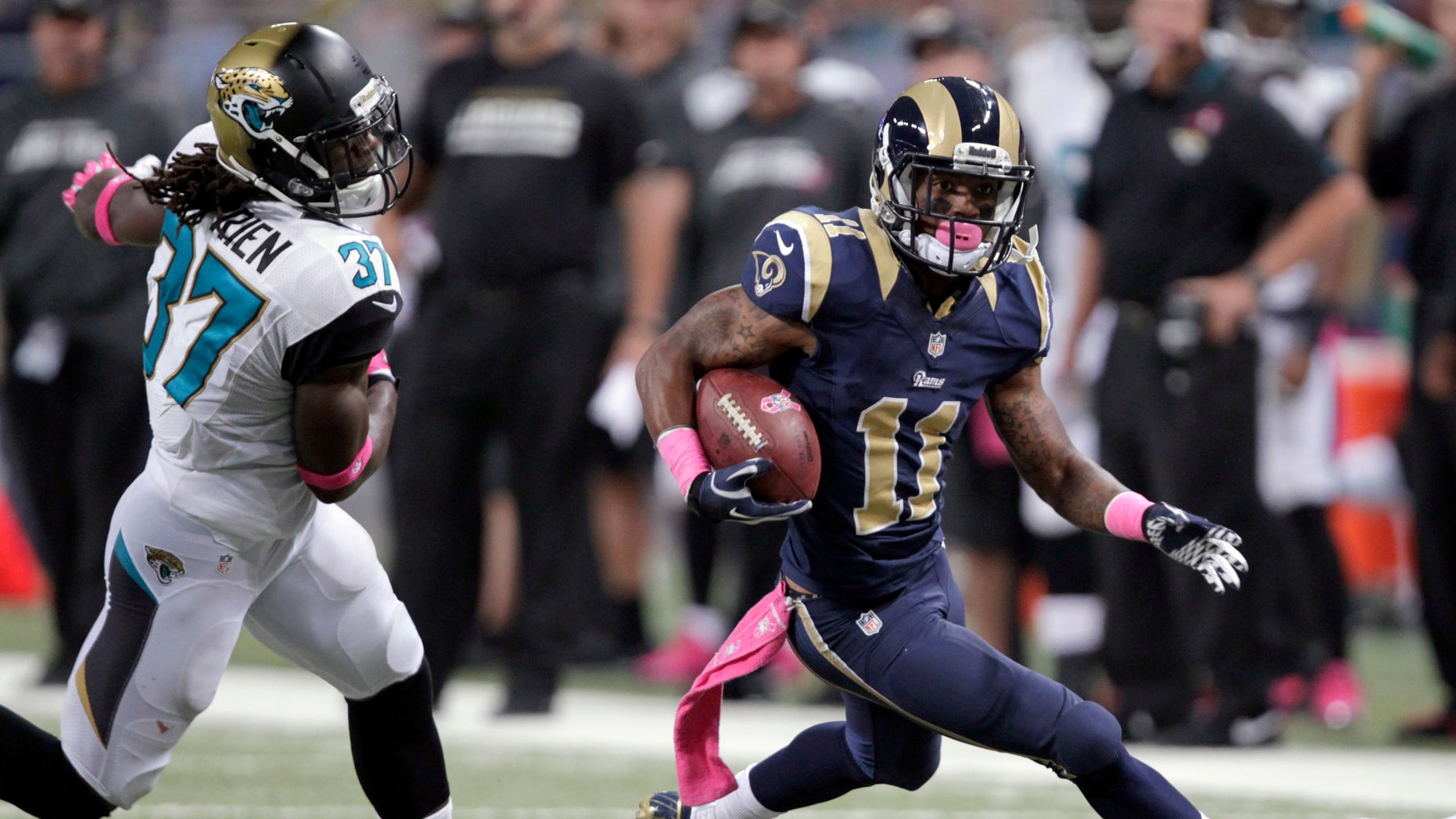 St. Louis Rams wide receiver Tavon Austin, right, runs with the ball past Jacksonville Jaguars safety John Cyprien, left, after catching a pass for a 25-yard gain during the second quarter of an NFL football game Sunday, Oct. 6, 2013, in St. Louis. (AP Photo/Tom Gannam)