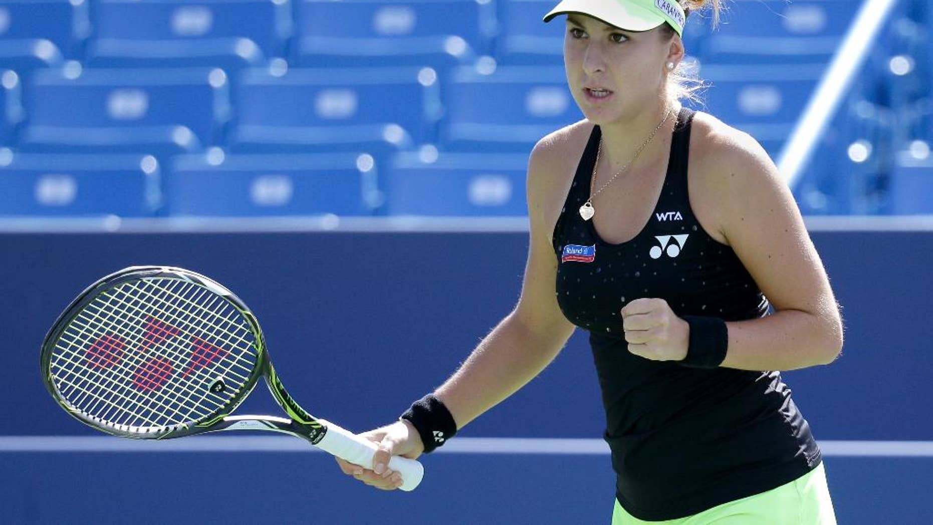 Belinda Bencic, of Switzerland, reacts during a match against Lucie Safarova, of the Czech Republic, at the Western & Southern Open tennis tournament, Thursday, Aug. 20, 2015, in Mason, Ohio. (AP Photo/John Minchillo)""