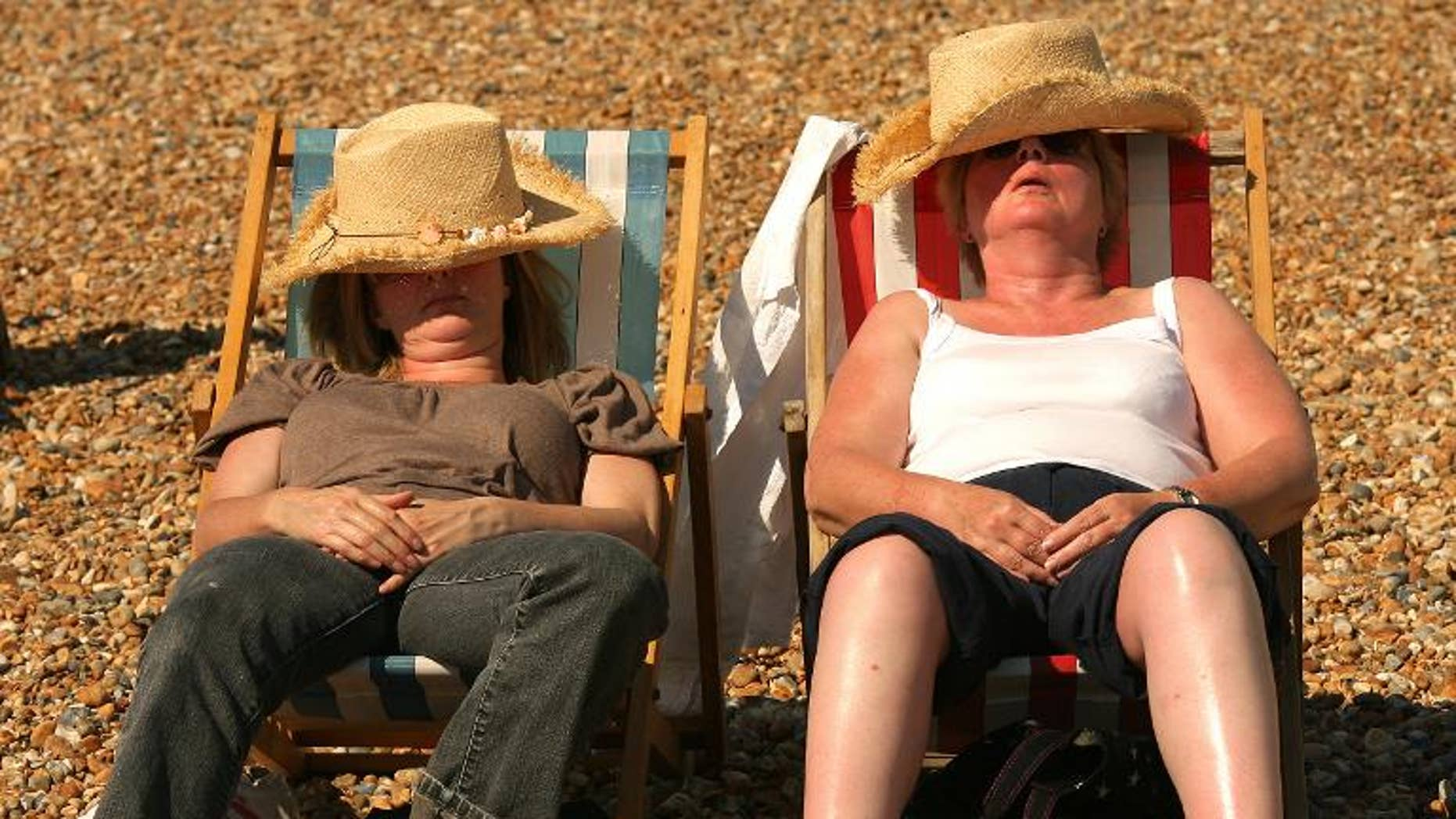 Sunbathers relax on Brighton beach in southern England on July 23, 2008.
