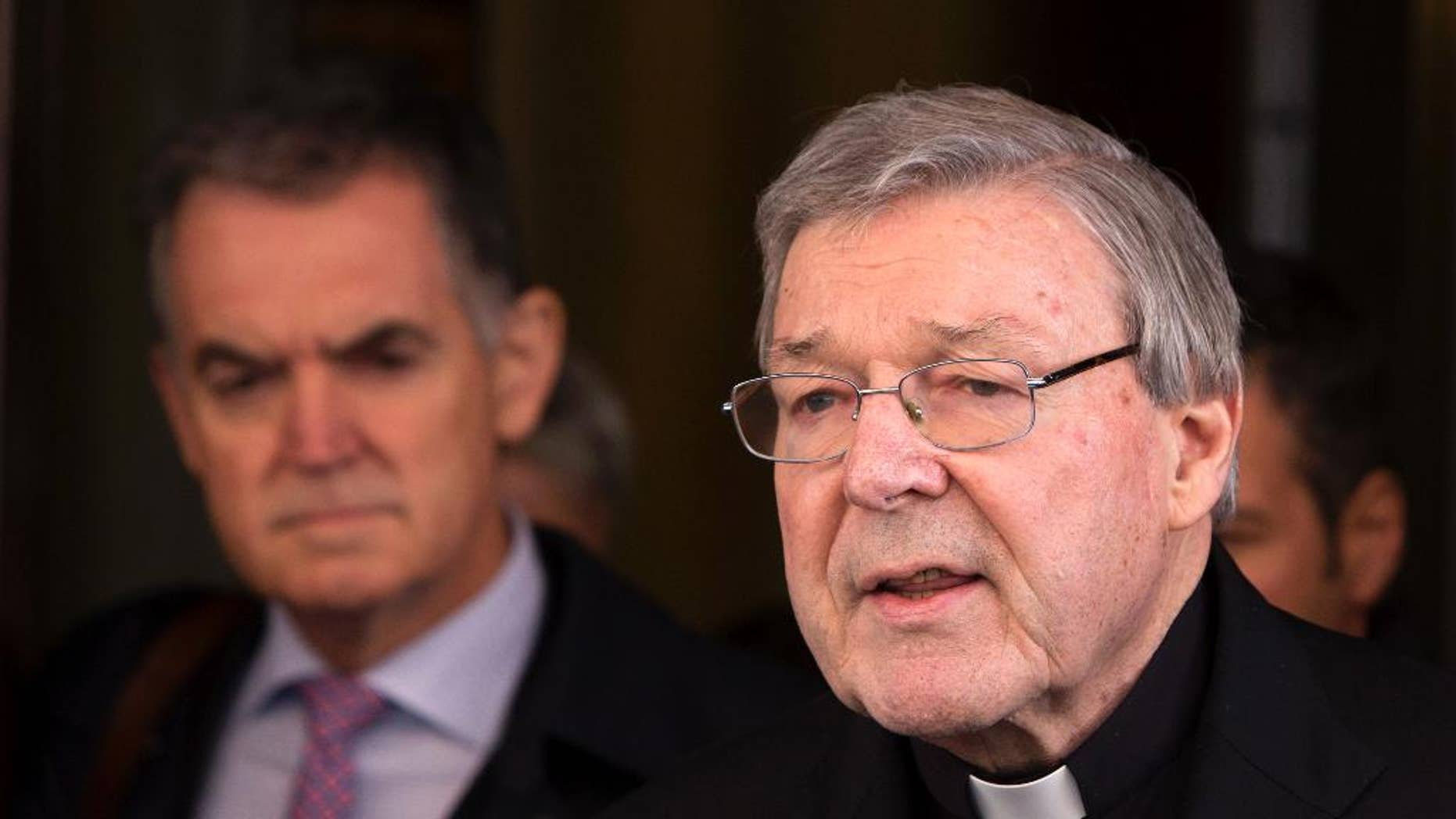 FILE - In this March 3, 2016 file photo, Australian cardinal George Pell reads a statement to reporters as he leaves the Quirinale hotel after meeting members of the Australian group of relatives and victims of priestly sex abuses, in Rome, Italy. Australian police flew to Rome to interview a top Vatican cardinal about allegations of sexual assault dating back decades, officials said Wednesday, Oct. 26, 2016. Cardinal George Pell, Pope Francis' top financial adviser, has long been dogged by allegations of mishandling cases of clergy abuse when he was archbishop of Melbourne and later Sydney.(AP Photo/Riccardo De Luca, File)