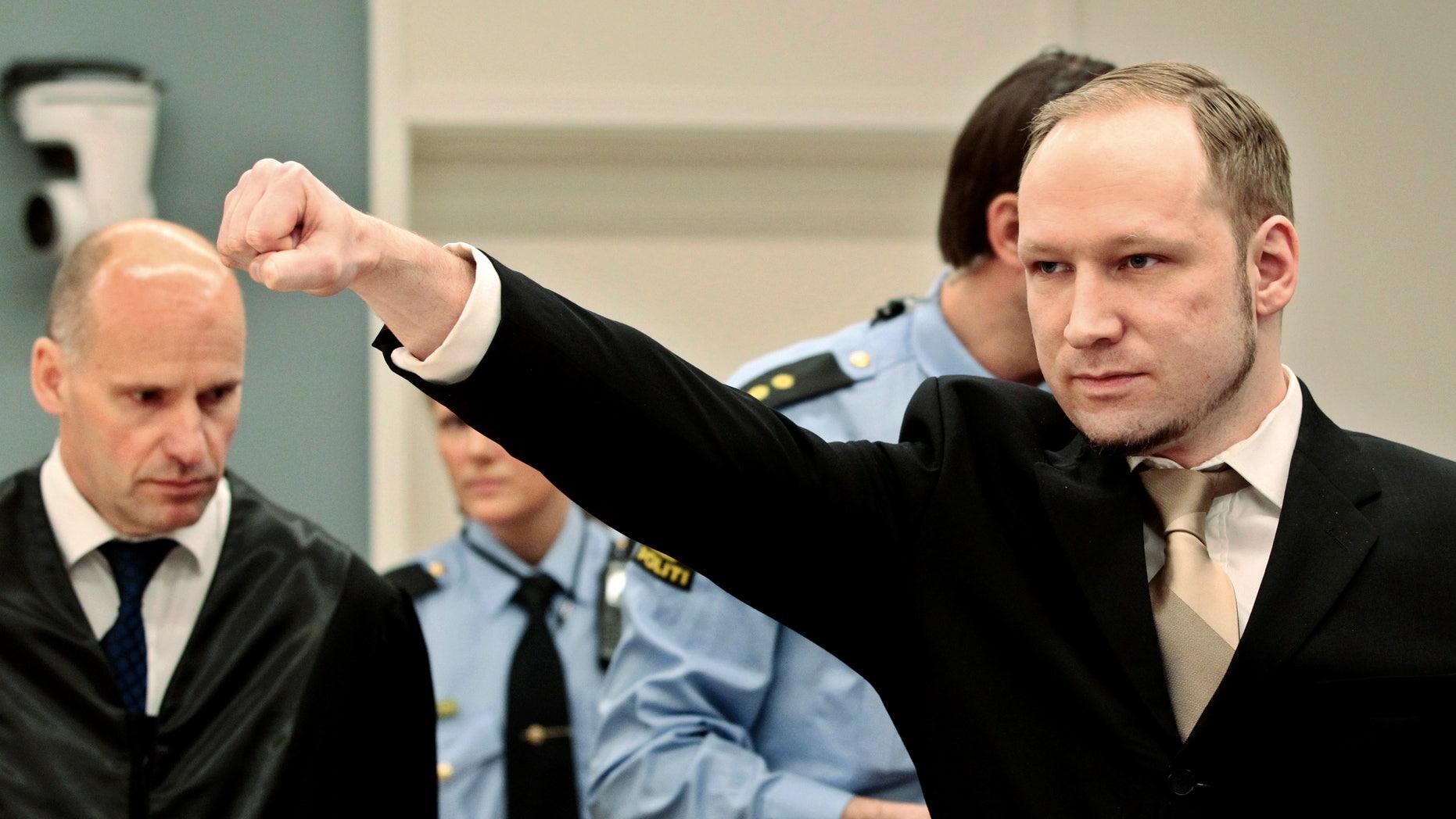 April 16, 2012: File photo of accused Norwegian Anders Behring Breivik as he  gestures as he arrives at the courtroom in Oslo, Norway.
