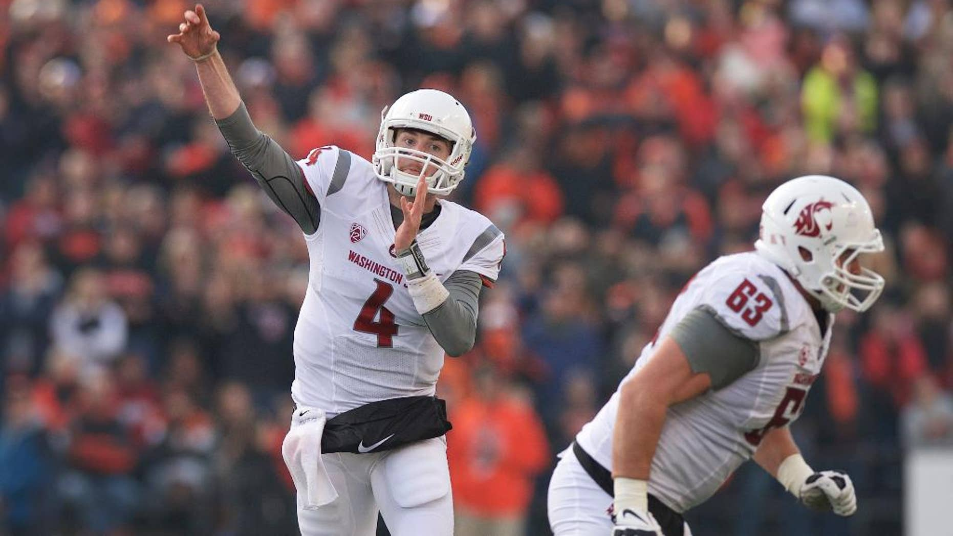 Washington State quarterback Luke Falk (4) throws a pass during an NCAA college football game against Oregon State in Corvallis, Ore., Saturday, Nov. 8, 2014. The Cougars beat the Beavers 39-32. (AP Photo/Troy Wayrynen)