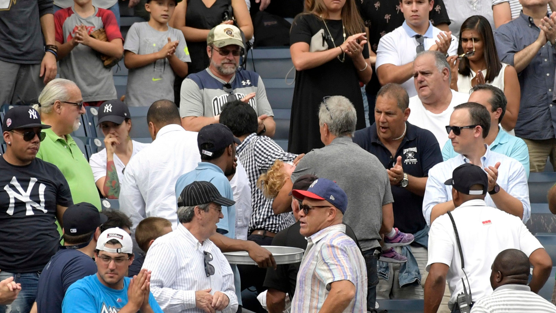 Baseball fans react after a toddler was hit by a foul ball Wednesday at Yankee Stadium.