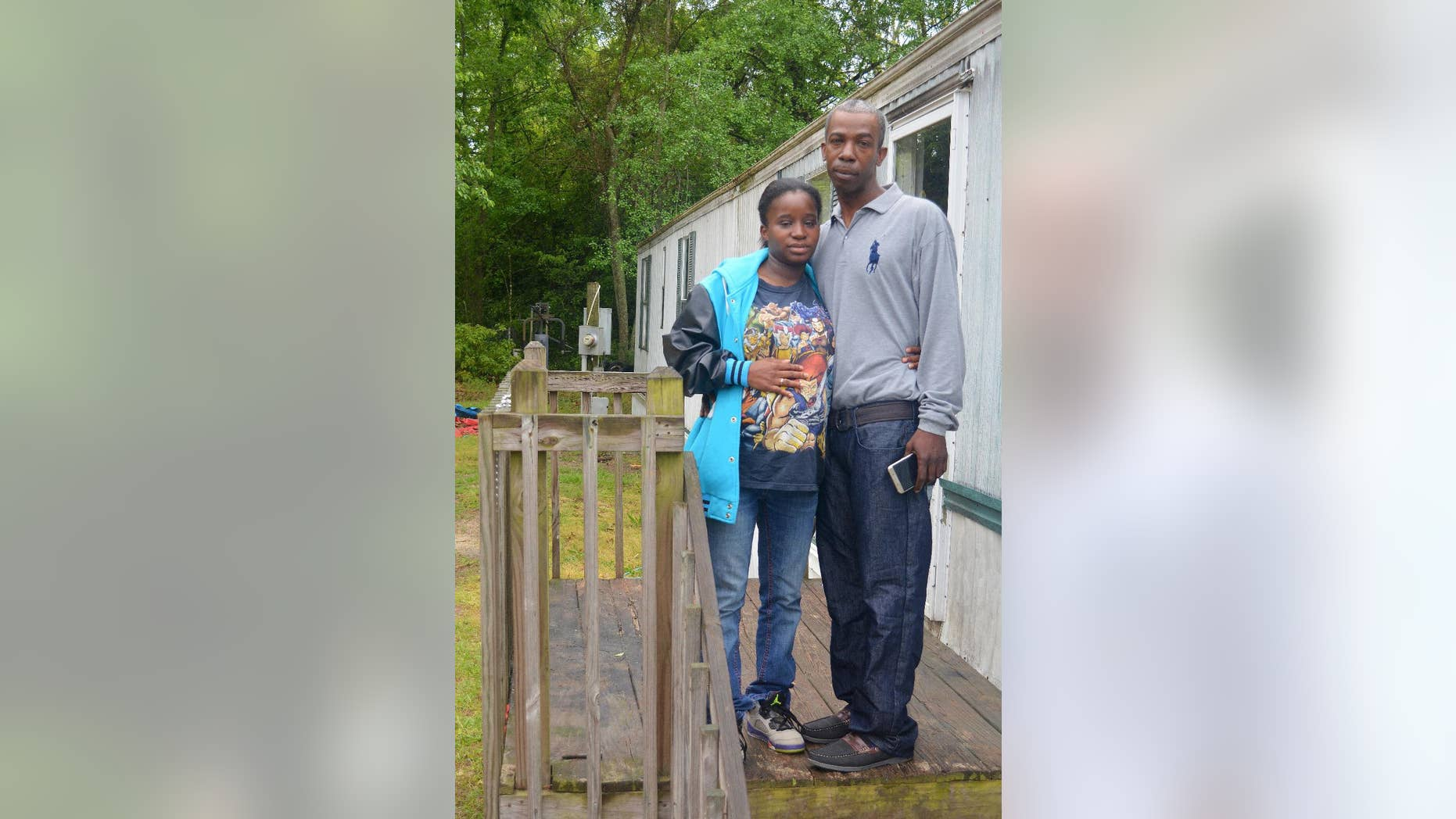 HFM April 13   In this April 12, 2016, photo, Lakeya Hicks and Elijah Pontoon stand outside their home in Aiken, South Carolina. The couple is speaking out about the 2014 traffic stop they say ended in public humiliation over an invasive cavity search for drugs that didn't exist. Hicks and Pontoon are suing the Aiken Department of Public Safety for illegally searching them on the side of a busy road. (AP Photo/Meg Kinnard)