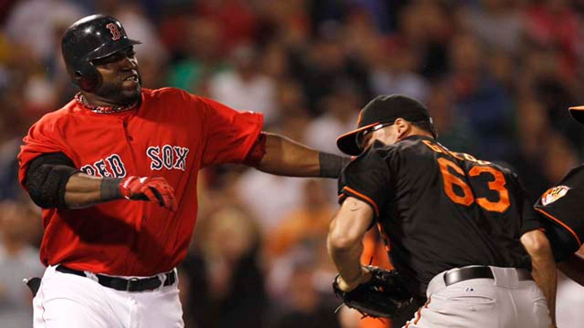 Boston Red Sox designated hitter David Ortiz takes a swing at Baltimore Orioles relief pitcher Kevin Gregg (63) after they exchanged words after Ortiz flied out during the eighth inning of a baseball game at Fenway Park in Boston on Friday, July 8, 2011. (AP Photo/Winslow Townson)