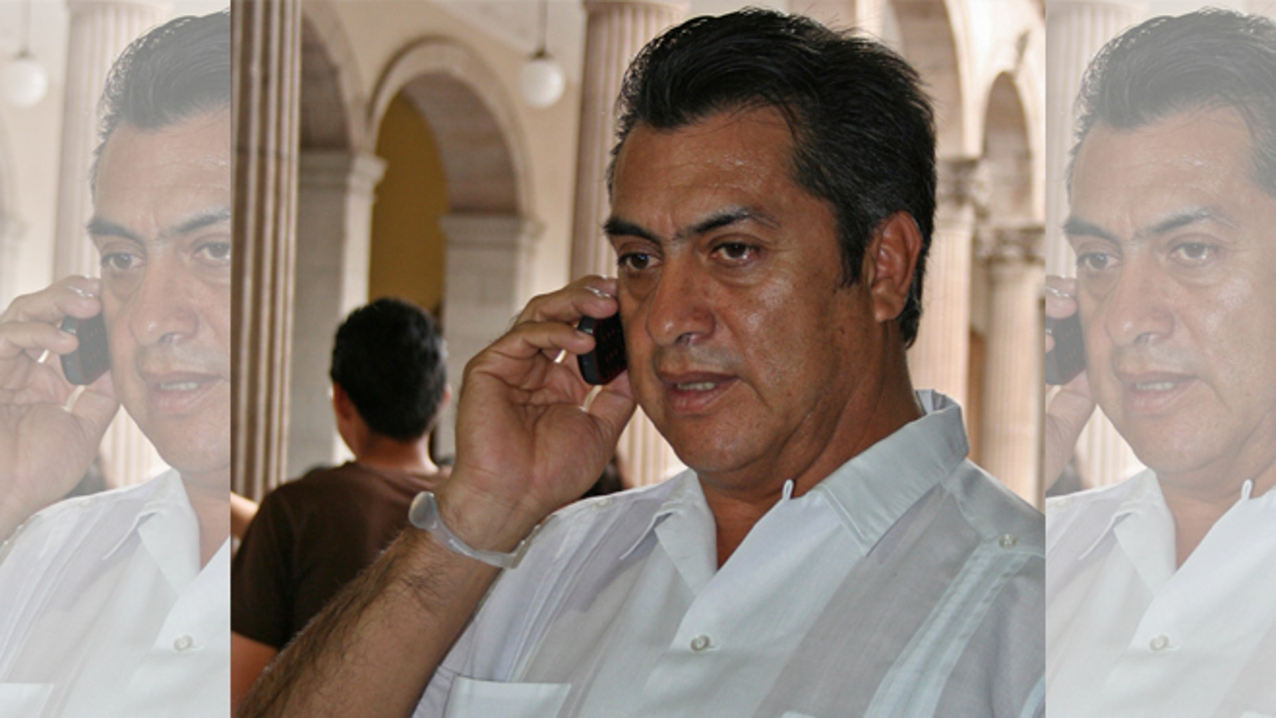FILE - In this March 30, 2011 file photo, Jaime Rodriguez, mayor of the Mexican town Villa Garcia, speaks on a cellphone in Monterrey, Mexico, a day after he survived an assassination attempt. As mayor of a suburb of the northern industrial city of Monterrey, Rodriguez survived two assassination attempts that left his car bullet-ridden, defying, he says, the fierce Zetas cartel. Now he is trying to beat the odds in another way, running as an independent for governor of Nuevo Leon, a wealthy and strategic state bordering Texas. (AP Photo, File)