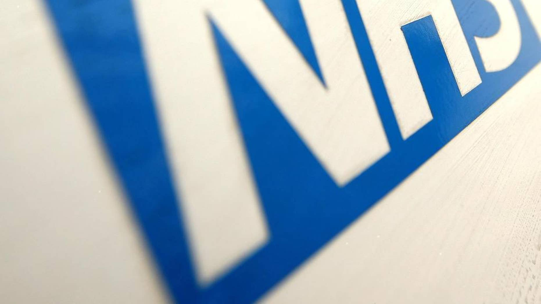 """FILE In this Dec. 12, 2010 file photo of the NHS Logo. The British Red Cross says overcrowding in hospital emergency rooms has become a """"humanitarian crisis."""" The charity says it has dispatched volunteers to help patients go home and free up hospital beds. It claims cuts to social-care funding by the Conservative government mean some patients can't be discharged because there is no support available, putting pressure on hospitals. Government supporters say the Red Cross is exaggerating the scale of the problem. (Dominic Lipinski/PA via AP, File)"""