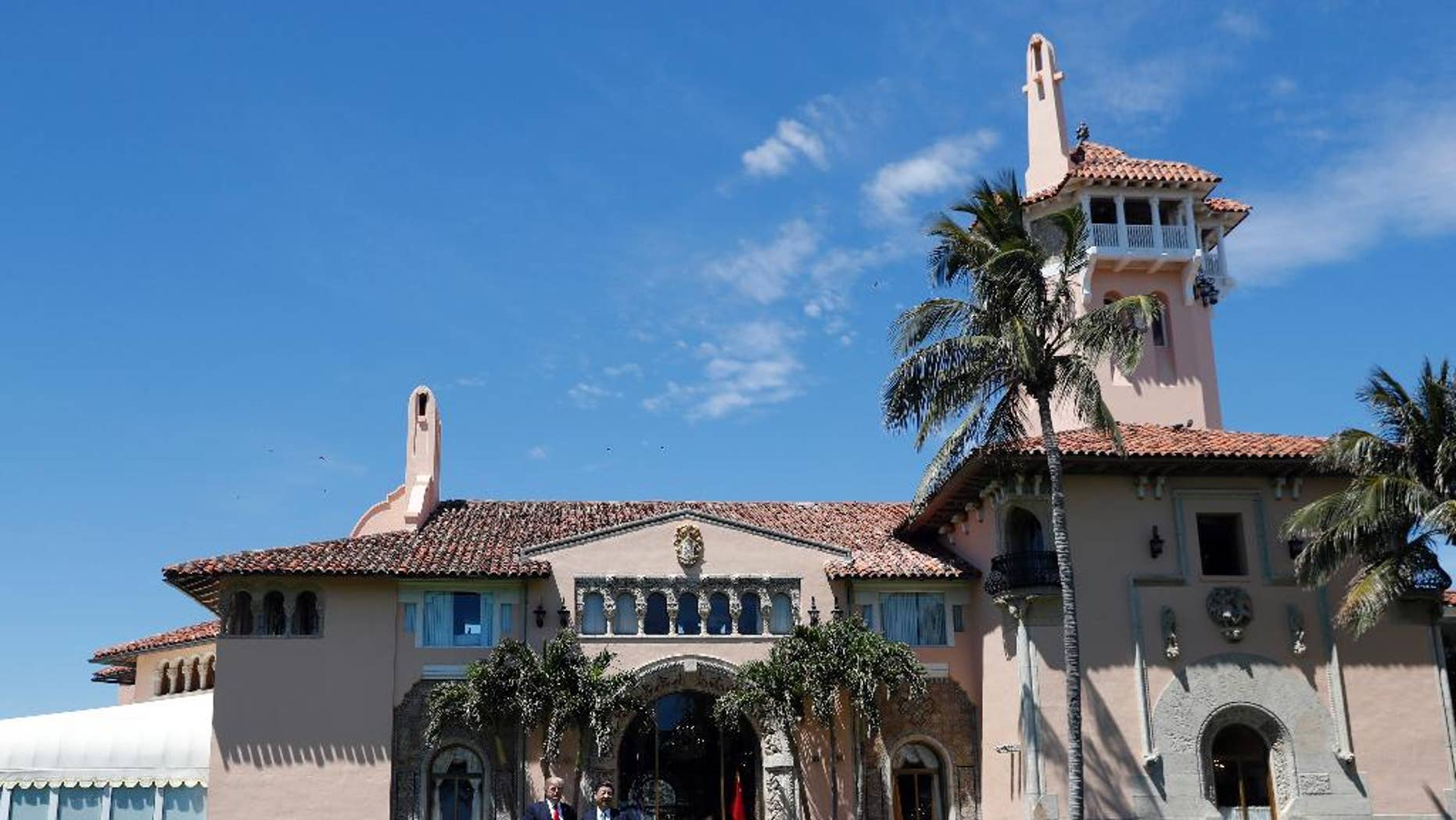 President Donald Trump, left, and Chinese President Xi Jinping pause in their walk after their meetings at Mar-a-Lago, Friday, April 7, 2017, in Palm Beach, Fla. (AP Photo/Alex Brandon)