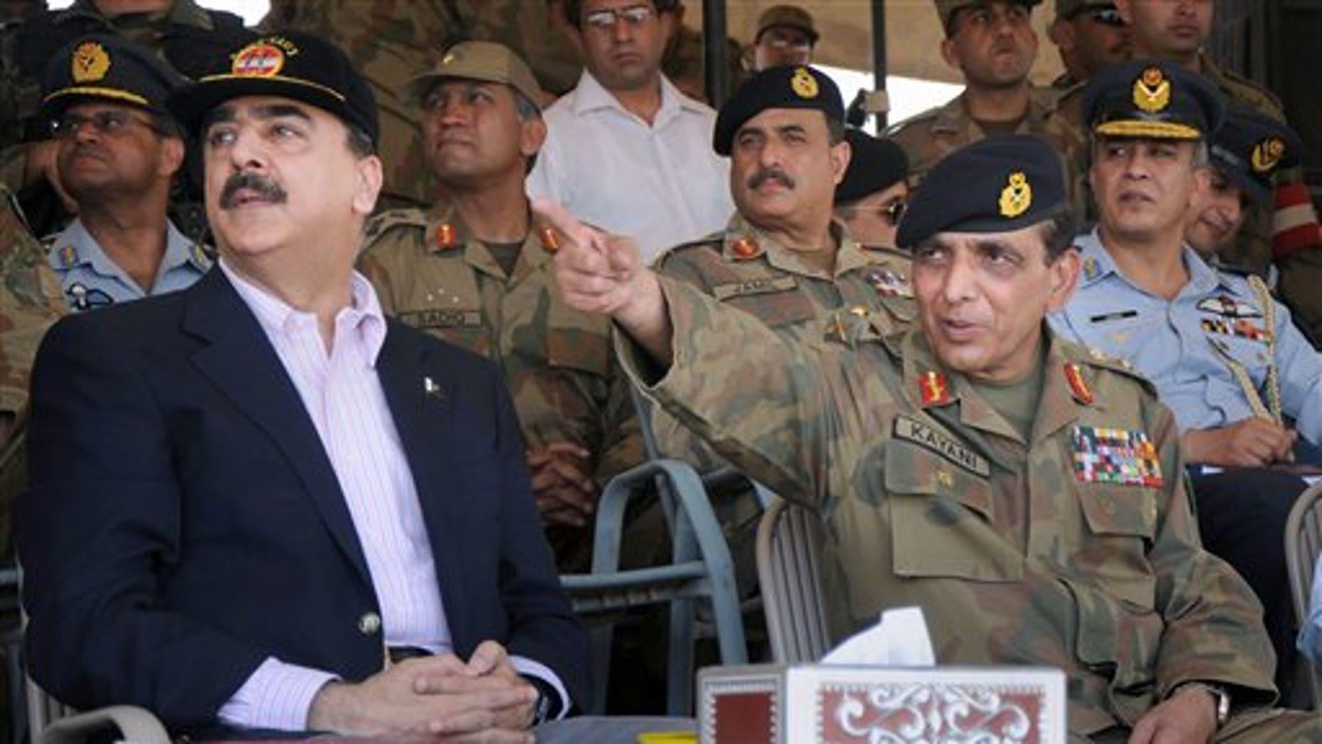 April 10, 2010: Pakistan's Army Chief Gen. Ashfaq Pervez Kayani, right, and Pakistan's Prime Minister Yousuf Raza Gilani, left, watch a military exercise in the Cholistan Desert near Bahawalpur, Pakistan.
