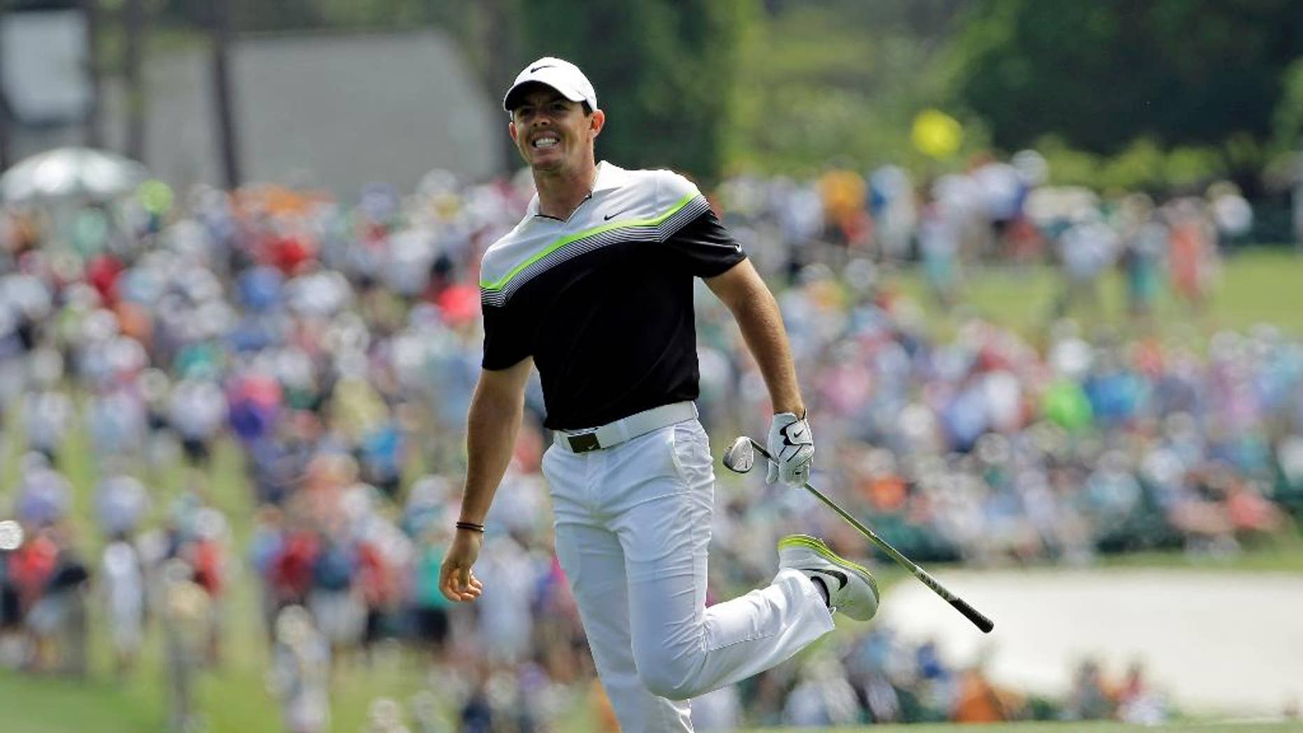 Rory McIlroy, of Northern Ireland, watches his shot after hitting on the first fairway during the third round of the Masters golf tournament Saturday, April 11, 2015, in Augusta, Ga. (AP Photo/David J. Phillip)