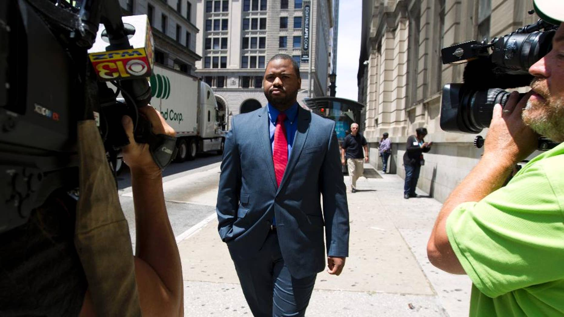 Baltimore police Officer William Porter, one of six Baltimore city police officers charged in connection to the death of Freddie Gray, leaves the courthouse, after testifying in the trial of Officer Caesar Goodson, Monday, June 13, 2016, in Baltimore Md. Porter's trial in the Gray case ended in mistrial. He will be tried again in September. (AP Photo/Jose Luis Magana)
