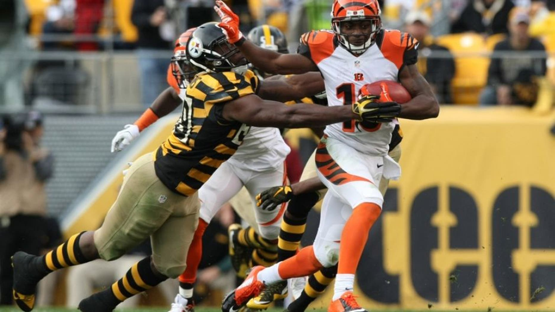 Nov 1, 2015; Pittsburgh, PA, USA; Cincinnati Bengals wide receiver Brandon Tate (19) runs the ball past Pittsburgh Steelers linebacker Vince Williams (98) during the second half at Heinz Field. The Bengals won the game 16-10. Mandatory Credit: Jason Bridge-USA TODAY Sports