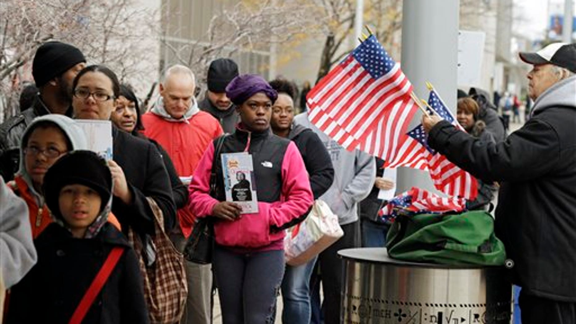 Voiters wait in line outside the Cuyahoga County Board of Elections in Cleveland on the final day of early voting Monday, Nov. 5, 2012. About 1.6 million people have voted early in Ohio. (AP Photo/Mark Duncan)
