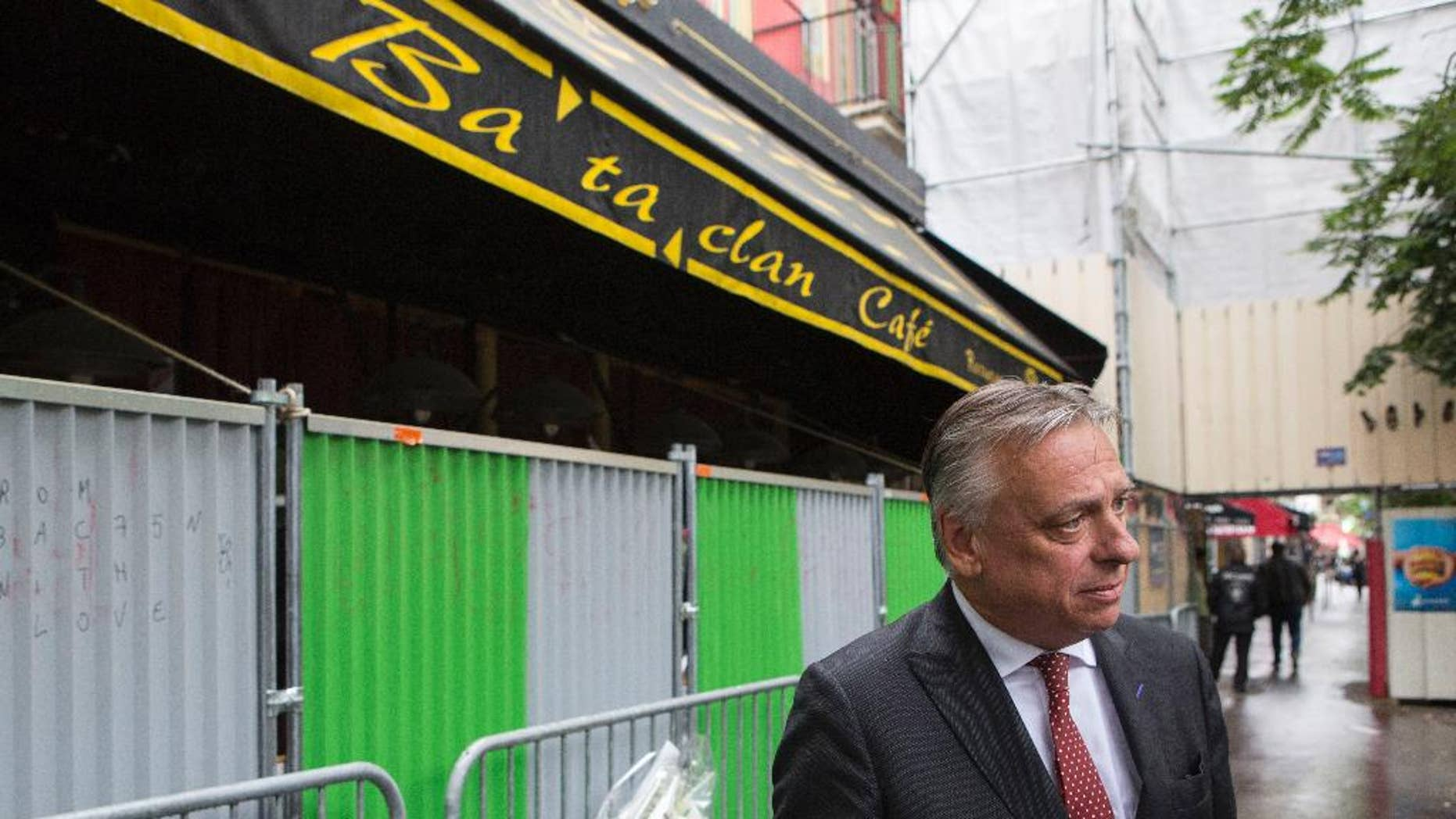 Patrick Dewael, head of the Belgian commission of inquiry, answers the media outside the Bataclan concert hall in Paris, Monday, June 20, 2016. Belgian lawmakers are joining forces with their French counterparts in examining the Islamic State cell that carried out deadly attacks in both Brussels and Paris. (AP Photo/Kamil Zihnioglu)
