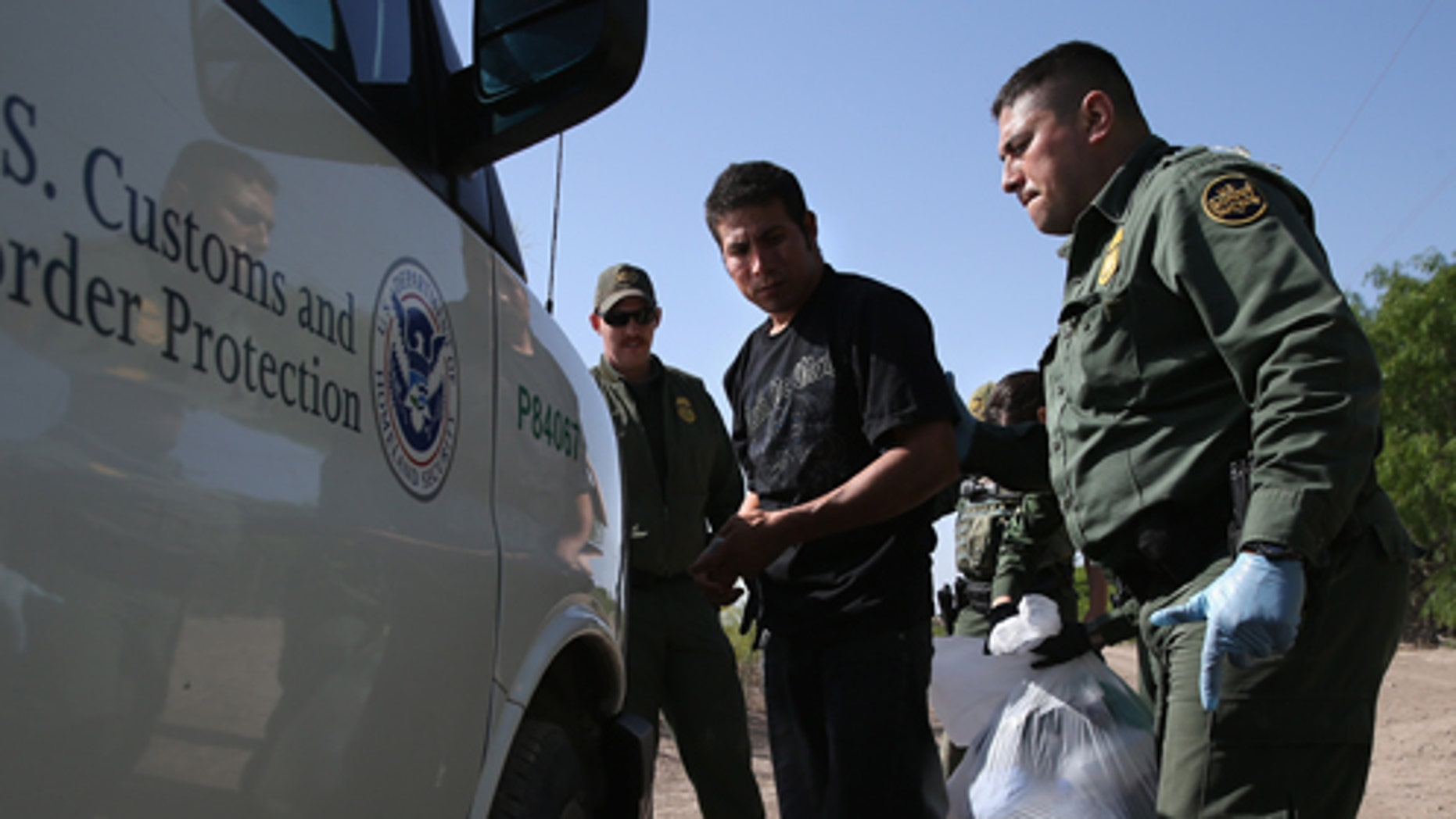 MISSION, TX - APRIL 11:  U.S. Border Patrol agents detain undocumented immigrants near the U.S.-Mexico border on April 11, 2013 near Mission, Texas. A group of 16 immigrants from Mexico and El Salvador said they crossed the Rio Grande River from Mexico into Texas during the morning hours before they were caught. The Rio Grande Valley sector of has seen more than a 50 percent increase in illegal immigrant crossings from last year, according to the Border Patrol. Agents say they have also seen an additional surge in immigrant traffic since immigration reform negotiations began this year in Washington D.C. Proposed refoms could provide a path to citizenship for many of the estimated 11 million undocumented workers living in the United States. Photo by John Moore/Getty Images)  (Photo by John Moore/Getty Images)