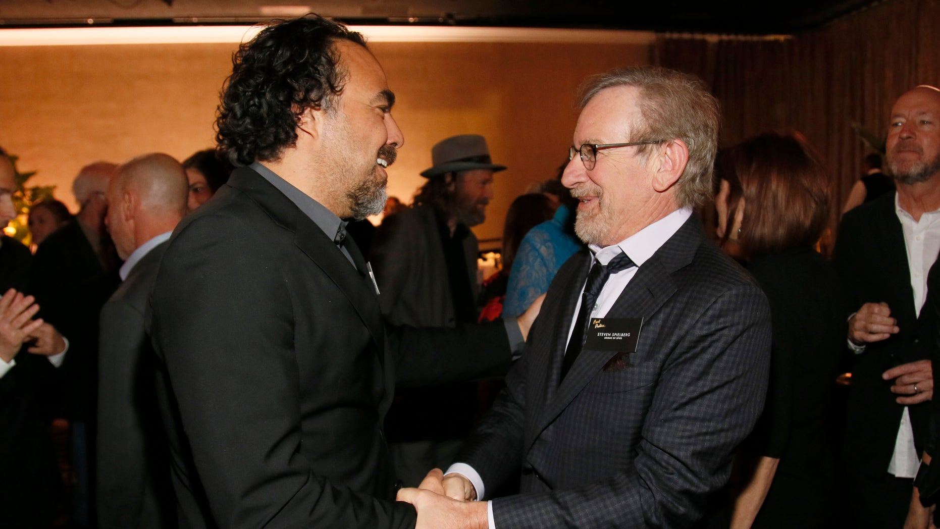 Alejandro Inarritu, left, and Steven Spielberg attend the 88th Academy Awards Nominees Luncheon at The Beverly Hilton hotel on Monday, Feb. 8, 2016, in Beverly Hills, Calif. (Photo by Danny Moloshok/Invision/AP)