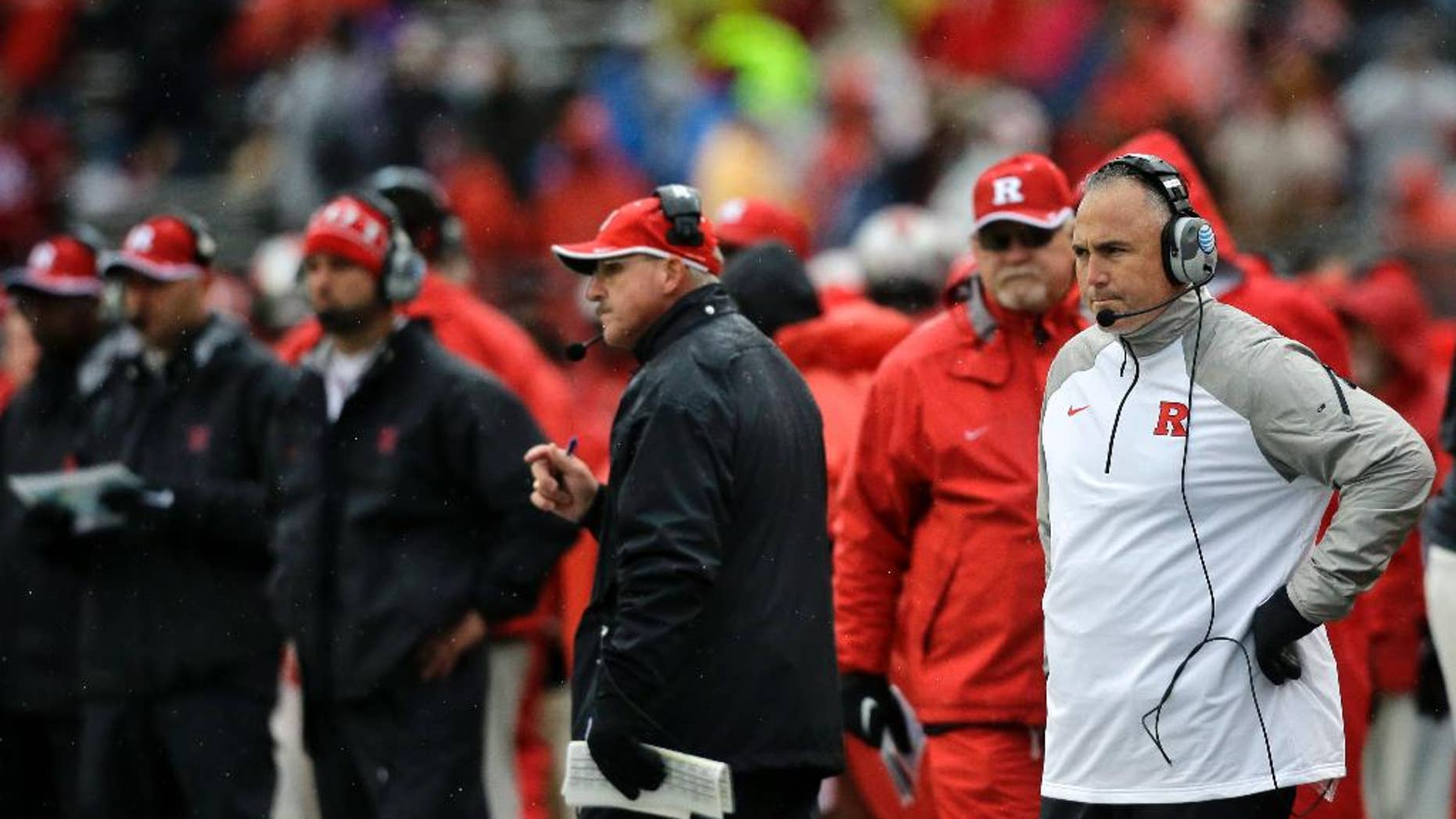 Rutgers head coach Kyle Flood, right, watches from the sidelines during the second half of an NCAA college football game against Wisconsin, Saturday, Nov. 1, 2014, in Piscataway, N.J. Wisconsin won 37-0. (AP Photo/Mel Evans)