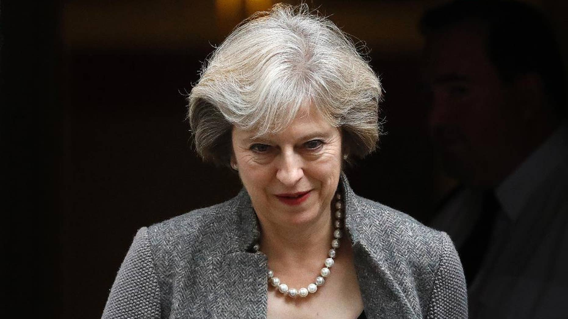 Britain's Prime Minister Theresa May leaves 10 Downing Street in London, Monday, Sept. 26, 2016. (AP Photo/Frank Augstein)