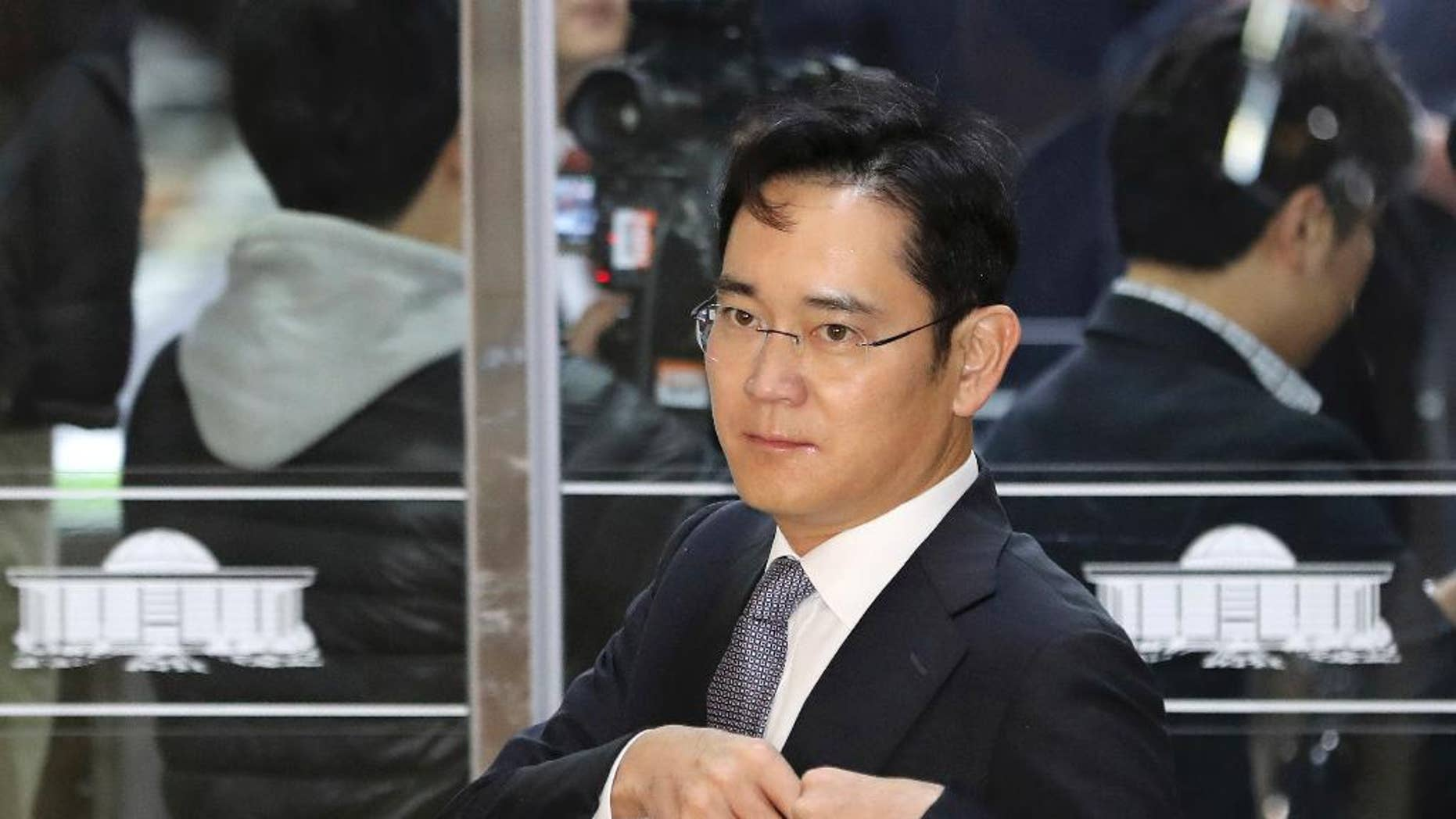 Lee Jae-yong, a vice chairman of Samsung Electronics Co. arrives for hearing at the National Assembly in Seoul, South Korea, Tuesday, Dec. 6, 2016. South Korea's most powerful business leaders from Samsung, Hyundai Motor and six other companies face grilling as lawmakers probe their links to a corruption scandal involving South Korea's president and her confidante. (AP Photo/Lee Jin-man)