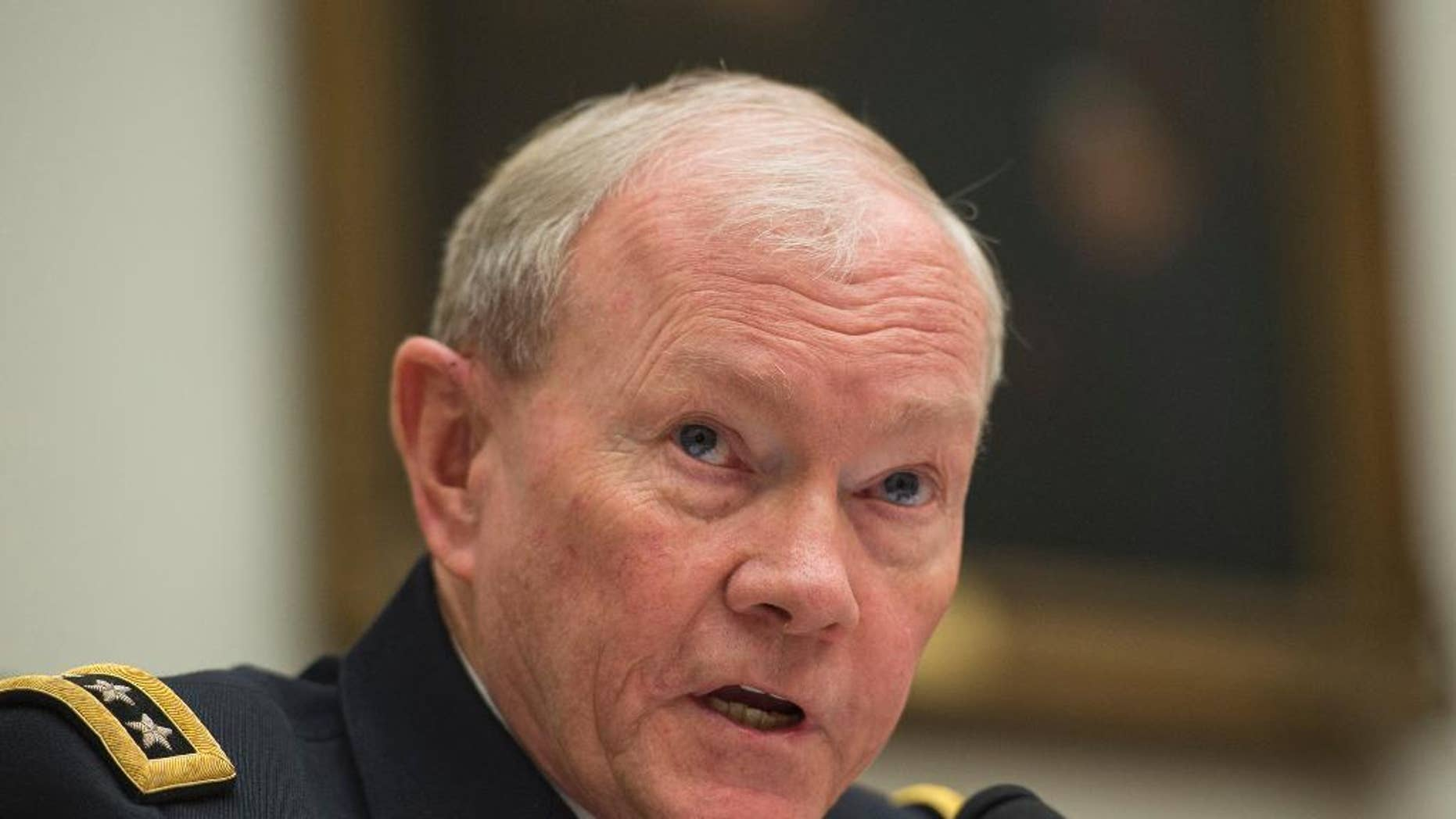 FILE - In this March 18, 2015, file photo, Joint Chiefs Chairman Gen. Martin Dempsey testifies on Capitol Hill in Washington. In the homestretch of a 41-year U.S. Army career shaped by war and the scars from it, Dempsey does not hide his skepticism that Iraq will find its own path to lasting victory over the Islamic State group. But neither does he say the threats to Iraq today justify sending American ground troops back into combat. He counsels patience, for now.  (AP Photo/Molly Riley, File)