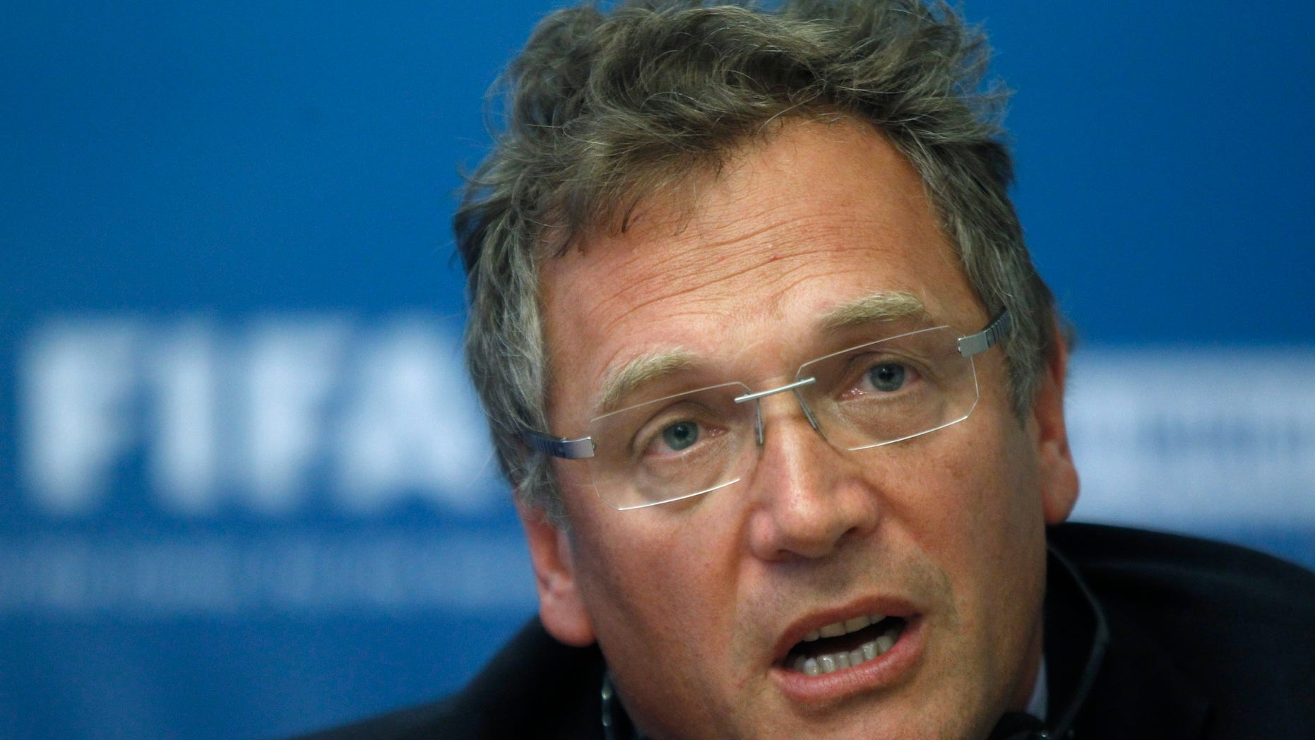 FILE - In this Tuesday, Oct. 11, 2011 file photo, FIFA General Secretary Jerome Valcke speaks during a news conference on Russia's preparations for the 2018 FIFA World Cup in Moscow, Russia. Valcke says the 2022 World Cup in Qatar will not be held in June or July because of the Gulf country's summer heat. (AP Photo/Mikhail Metzel, File)