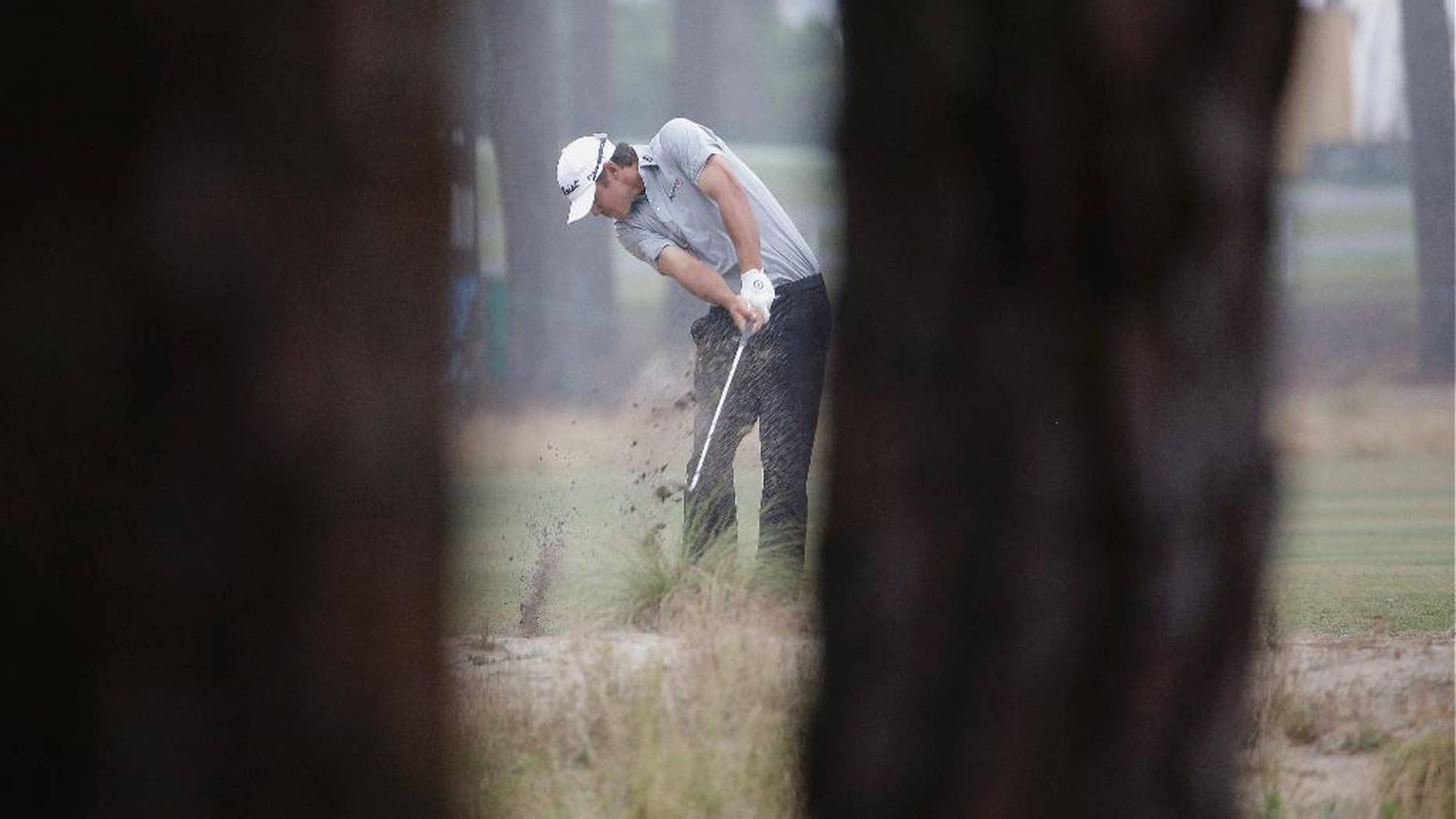 Brooks Koepka hits from the natural area on the 12th hole during the second round of the U.S. Open golf tournament in Pinehurst, N.C., Friday, June 13, 2014. (AP Photo/David Goldman)
