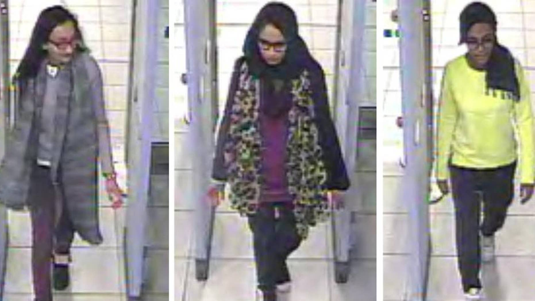 """FILE - This is a Monday Feb. 23, 2015 file handout image  of a three image combo of stills taken from CCTV issued by the Metropolitan Police  Kadiza Sultana,  left, Shamima Begum, centre and and  Amira Abase going through security at Gatwick airport, before they caught their flight to Turkey. A lawyer said one of three London schoolgirls who traveled to Islamic State-controlled area of Syria to become """"jihadi brides"""" is believed to have been killed in an air strike. Tasnime Akunjee told the BBC Friday Aug. 12, 2016 that Kadiza Sultana's family had been told that she died in the IS stronghold of Raqqa several weeks ago. (Metropolitan Police via AP)"""