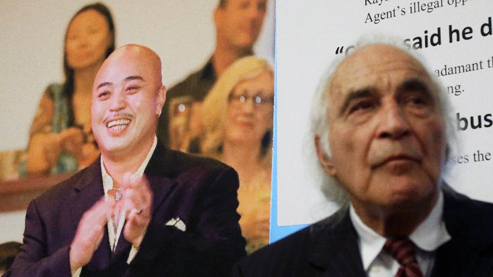 """FILE - In this April 10, 2014 file photo, Tony Serra, right, an attorney for Raymond """"ShrimpBoy"""" Chow, pictured at left, listens to speakers at a news conference in San Francisco. Chow, a dapper former San Francisco gang leader who portrayed himself as a reformed criminal, was the focus of a lengthy organized crime investigation in Chinatown that ended up snaring a corrupt California senator and more than two dozen others. Closing arguments are expected Monday, Jan. 4, 2016, in the racketeering and murder case against Chow. (AP Photo/Jeff Chiu, File)"""