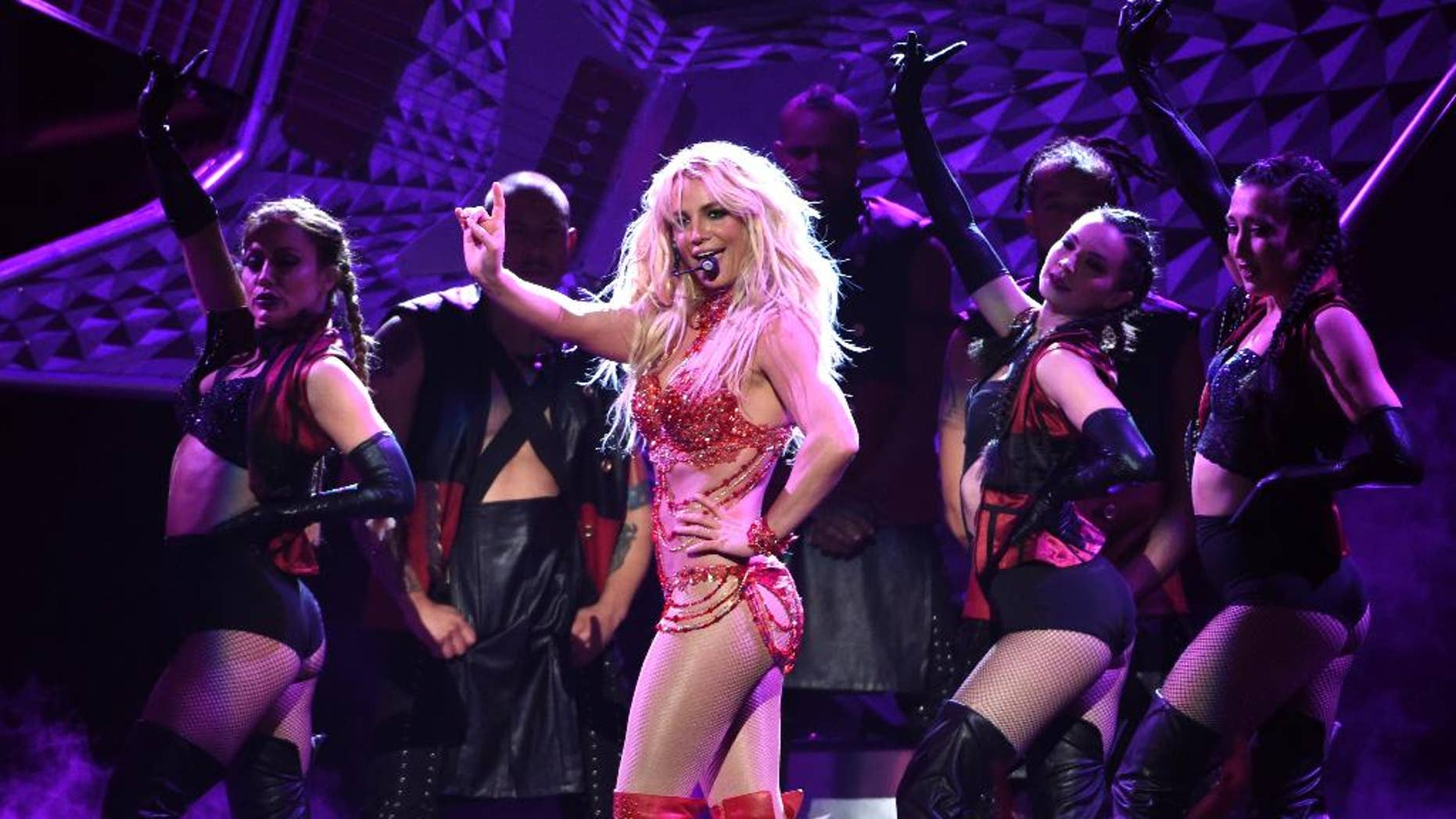 """FILE - In this May 22, 2016 file photo, Britney Spears performs at the Billboard Music Awards at the T-Mobile Arena, in Las Vegas. Spears will return to the MTV Video Music Awards stage to perform her new single, """"Make Me...,"""" at the Aug. 28 show at Madison Square Garden in New York. She last performed at the 2007 VMAs. (Photo by Chris Pizzello/Invision/AP, File)"""