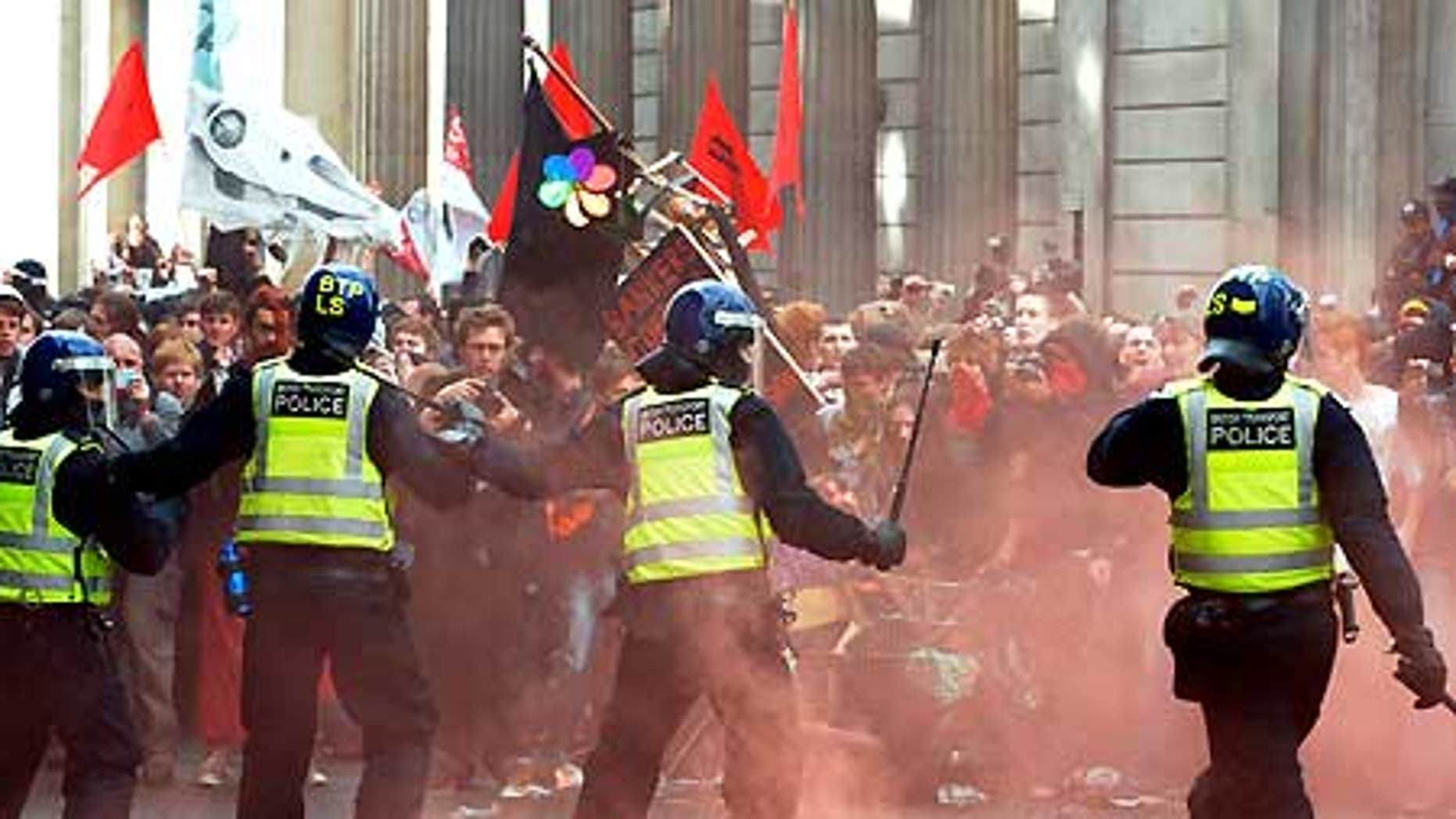 April 1: Riot police confront protesters near the Bank of England in London.
