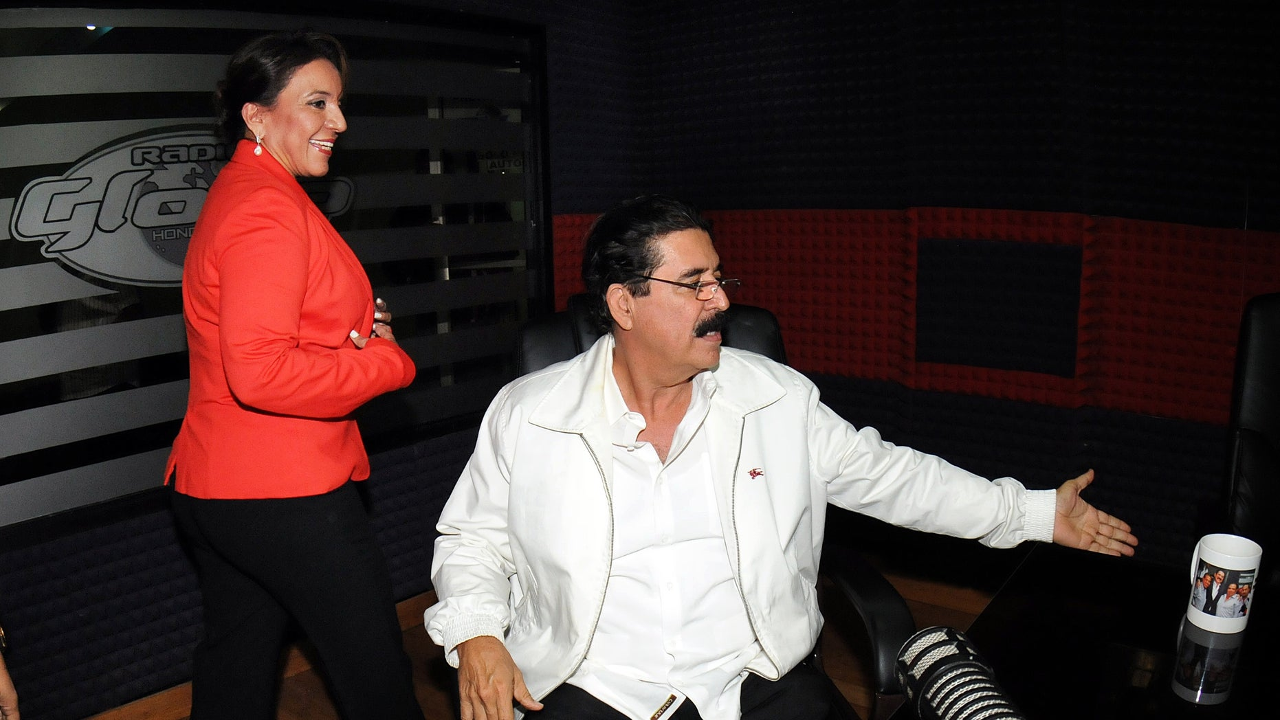 Free Party Presidential candidate Xiomara Castro, left, and her husband, ousted President Manuel Zelaya, arrive for an radio interview in Tegucigalpa, Honduras, Wednesday Nov. 27, 2013. Castro spoke about last Sunday's election results which declared ruling party candidate Juan Orlando Hernandez the winner, saying that there was fraud in the elections and that she will present the evidence Friday. (AP Photo/Fernando Antonio)