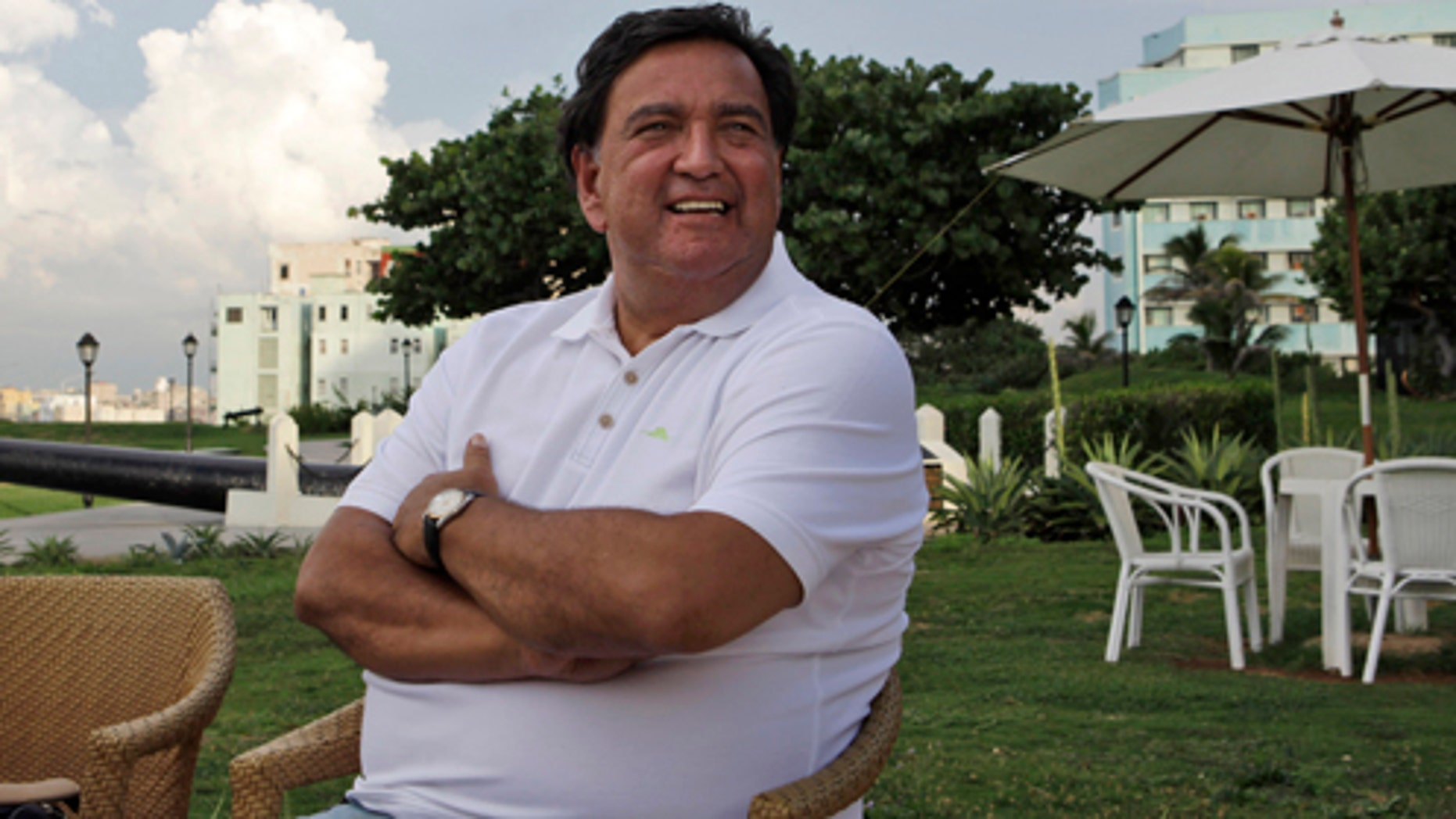 Former New Mexico Gov. Bill Richardson smiles as he sits at an area outside a bar in the National hotel in Havana, Cuba, Wednesday, Sept. 7, 2011. Richardson arrived in Cuba on Wednesday to seek the freedom of a U.S. government subcontractor Alan Gross sentenced to 15 years in prison for bringing communications equipment to the island illegally. (AP Photo/Javier Galeano)