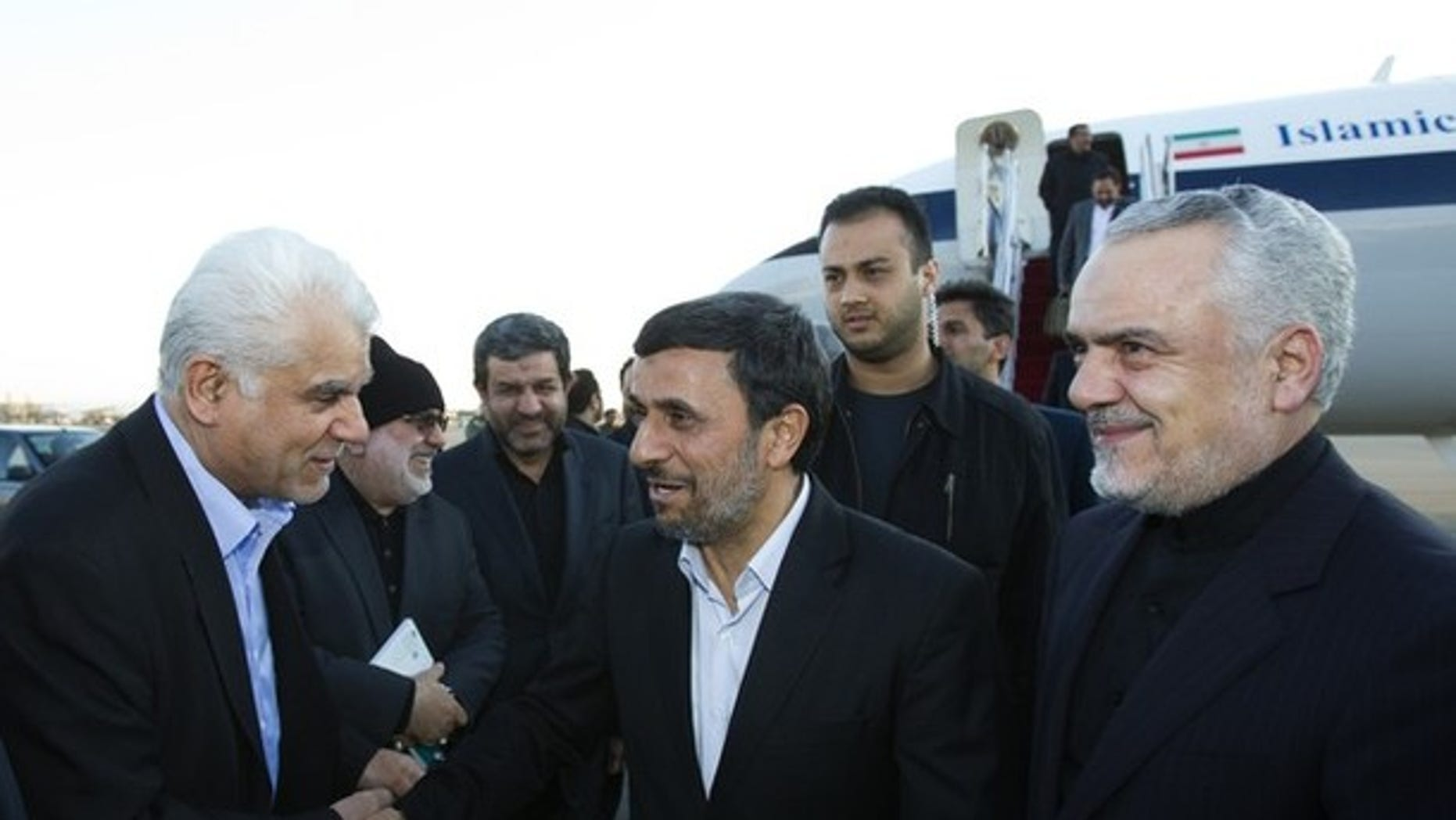 Jan. 14, 2012: Iran's President Mahmoud Ahmadinejad (C) as First Vice President Mohammad Reza Rahimi looks on at Tehran's Mehrabad airport after Ahmadinejad's visit to Latin American countries
