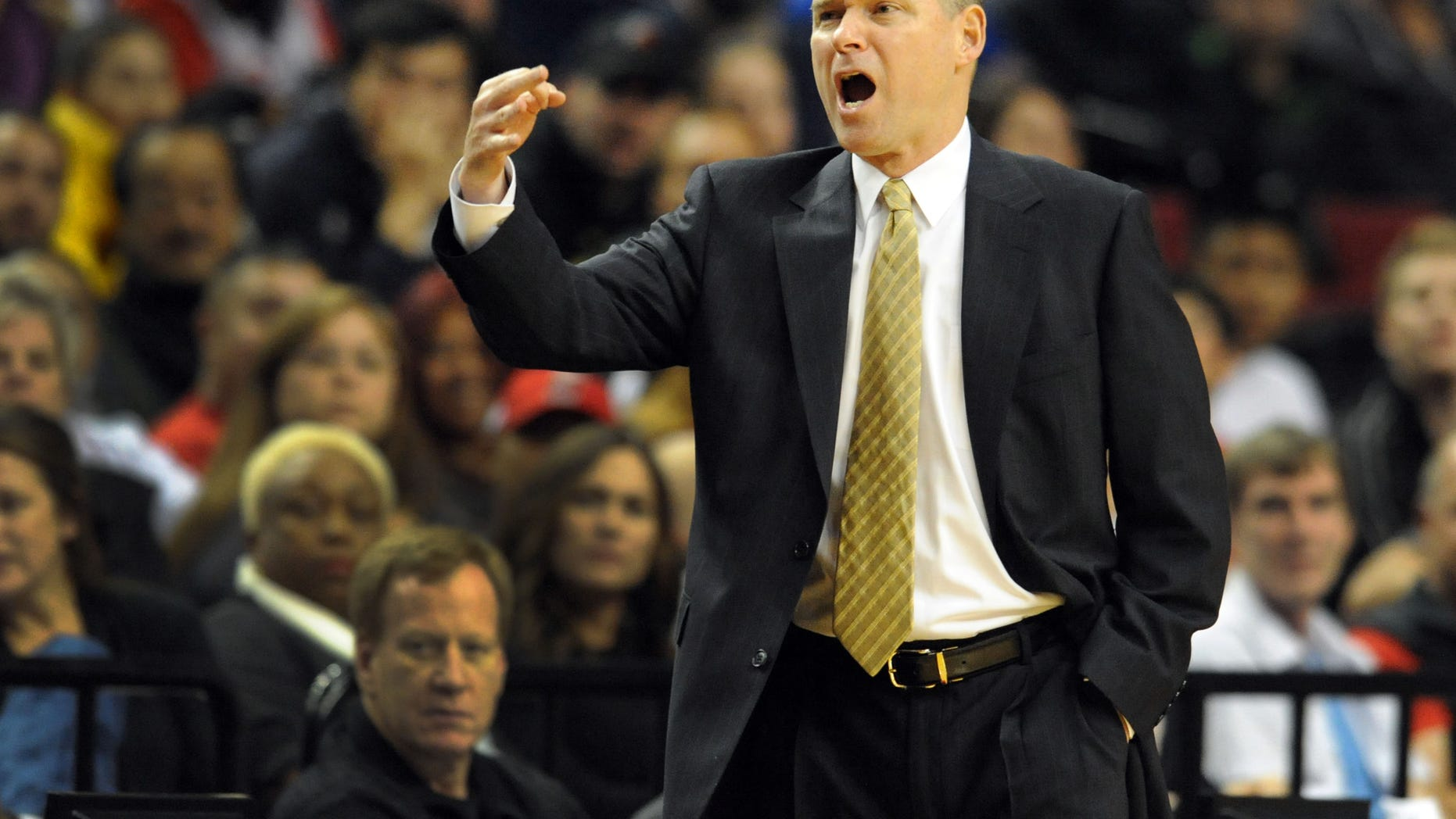Sacramento Kings head coach Michael Malone yells out to the officials during the first half of an NBA basketball game against the Portland Trail Blazers onSunday, Oct. 20, 2013, in Milwaukee. (AP Photo/Steve Dykes)