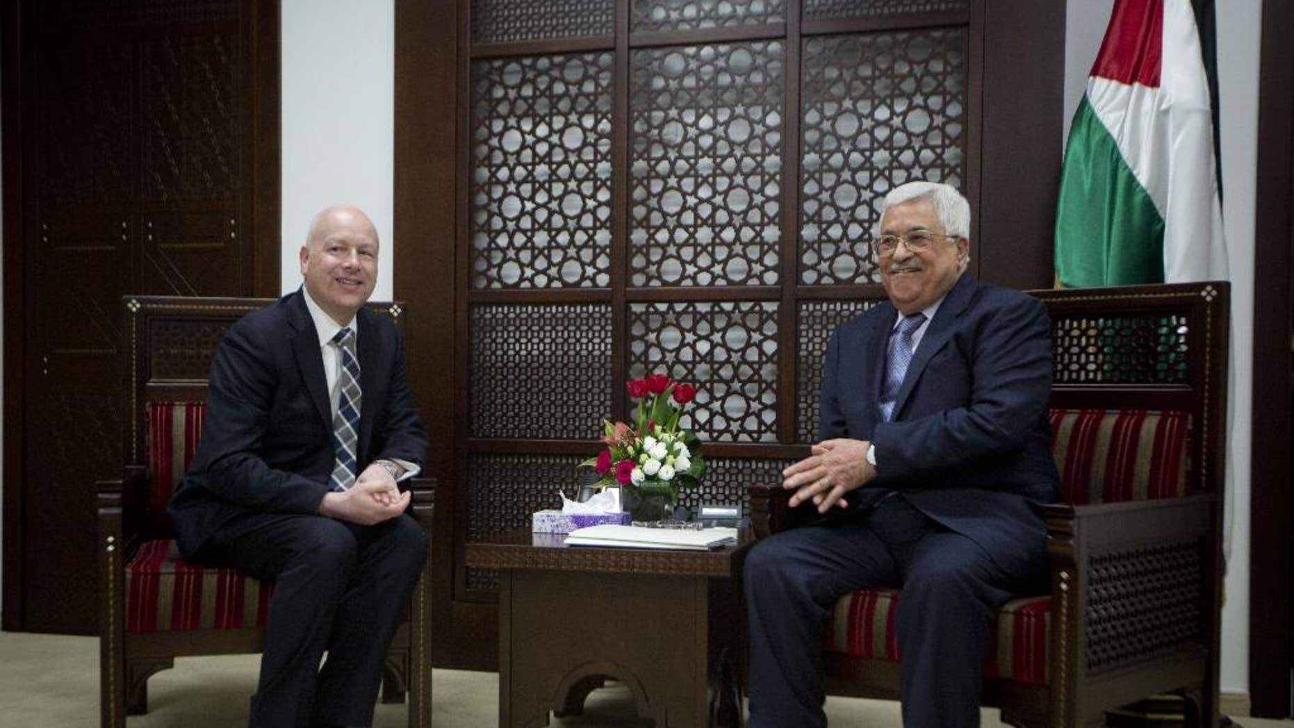 US President's peace process envoy Jason Greenblatt, left, meets with Palestinian President Mahmoud Abbas at the President's office in the West Bank city of Ramallah, Tuesday, March 14, 2017. (AP Photo/Majdi Mohammed)