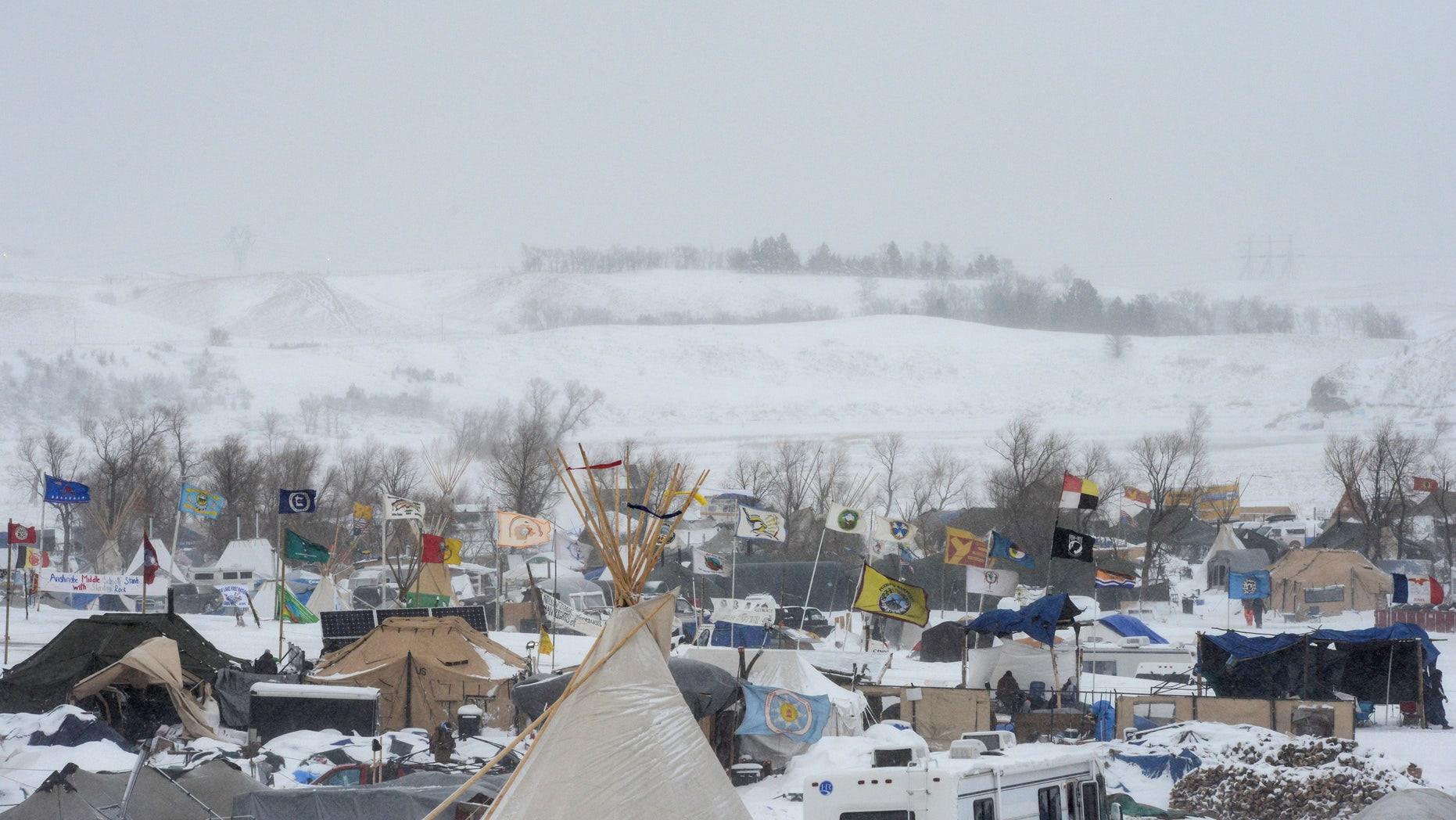 The Oceti Sakowin camp is seen in a snow storm during a protest against plans to pass the Dakota Access pipeline near the Standing Rock Indian Reservation, near Cannon Ball, North Dakota, U.S. November 29, 2016.