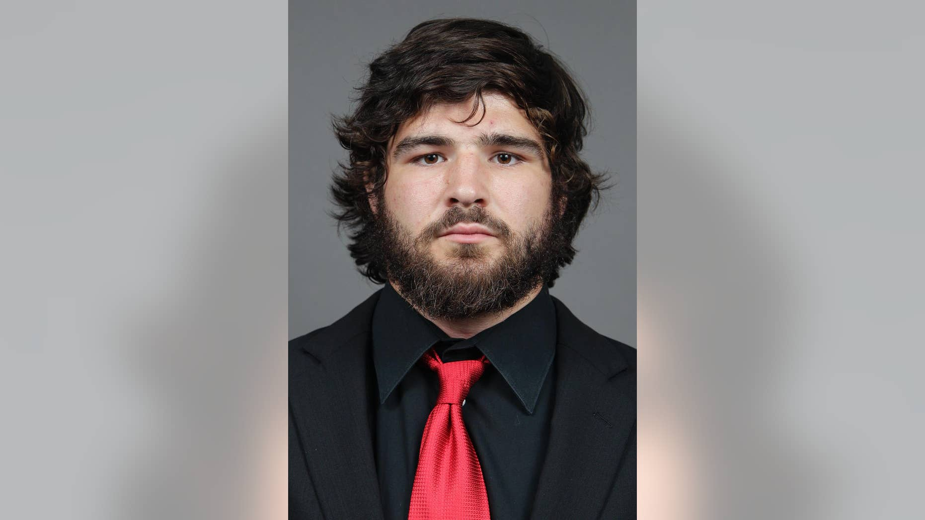 This photo taken on Wednesday, Sept. 11, 2013, and provided by Ohio State university shows college football player Kosta Karageorge in Columbus, Ohio.  The mother of a missing Ohio State football player has told police he texted her about his prior concussions the morning he disappeared. A missing-person report filed with Columbus police Wednesday evening, Nov. 26, 2014, says Karageorge told his mother he was sorry if he was an embarrassment but concussions had his head messed up. The 6-foot-5 senior missed practice Wednesday and Thursday and has not been heard from. (AP Photo/Ohio State University, Jay LaPrete)