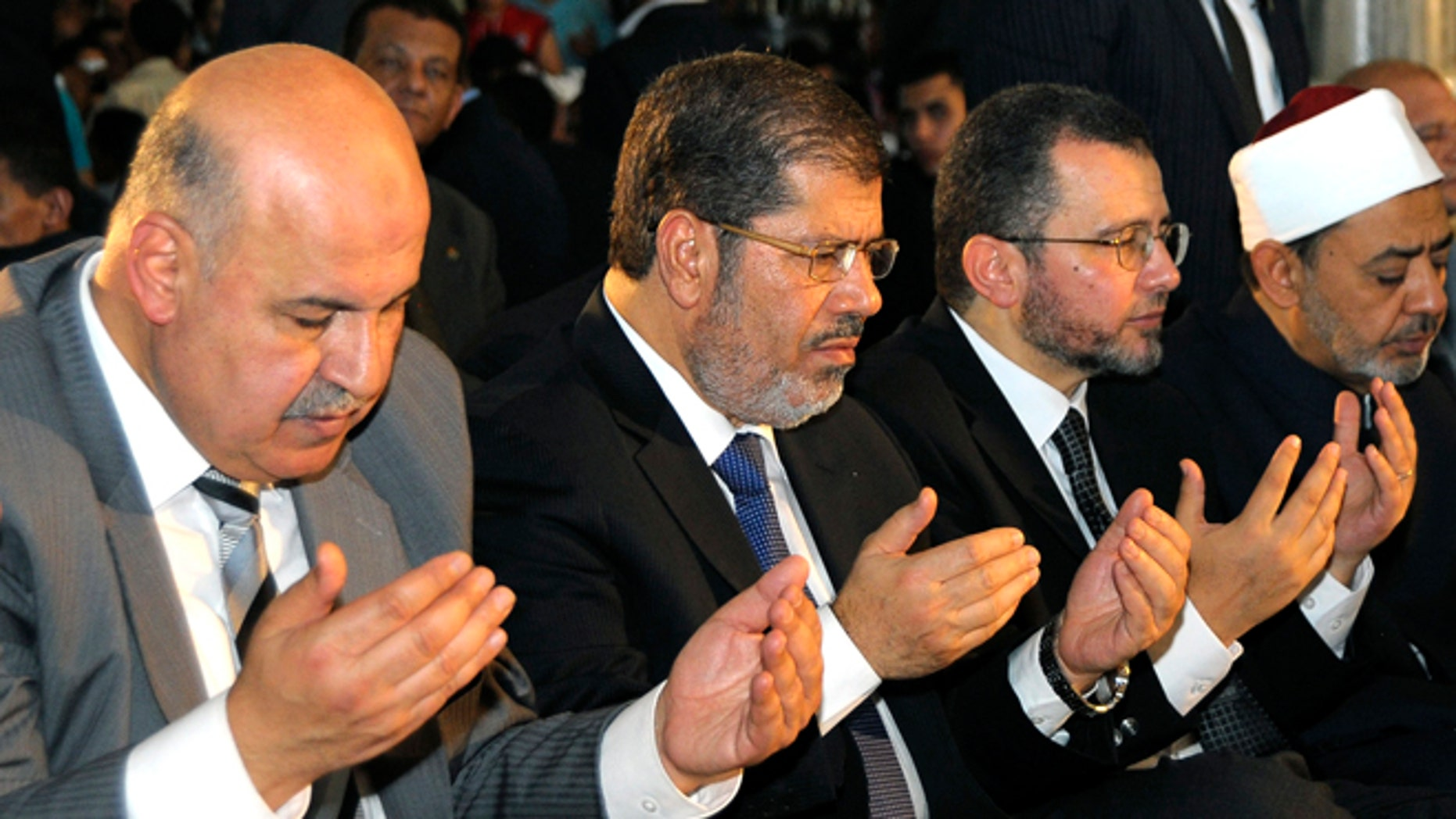 Aug. 19, 2012: Egyptian Vice President, Mahmoud Mekki, left, President Mohammed Morsi, second left, Prime Minister Hesham Kandil, third left, and the Grand Sheik of Al-Azhar, Ahmed el-Tayeb, right, attend Eid al-Fitr prayers in Amr Ibn Al-As mosque to mark the start of a three-day Muslim holiday that marks the end of the Muslim holy month of Ramadan.